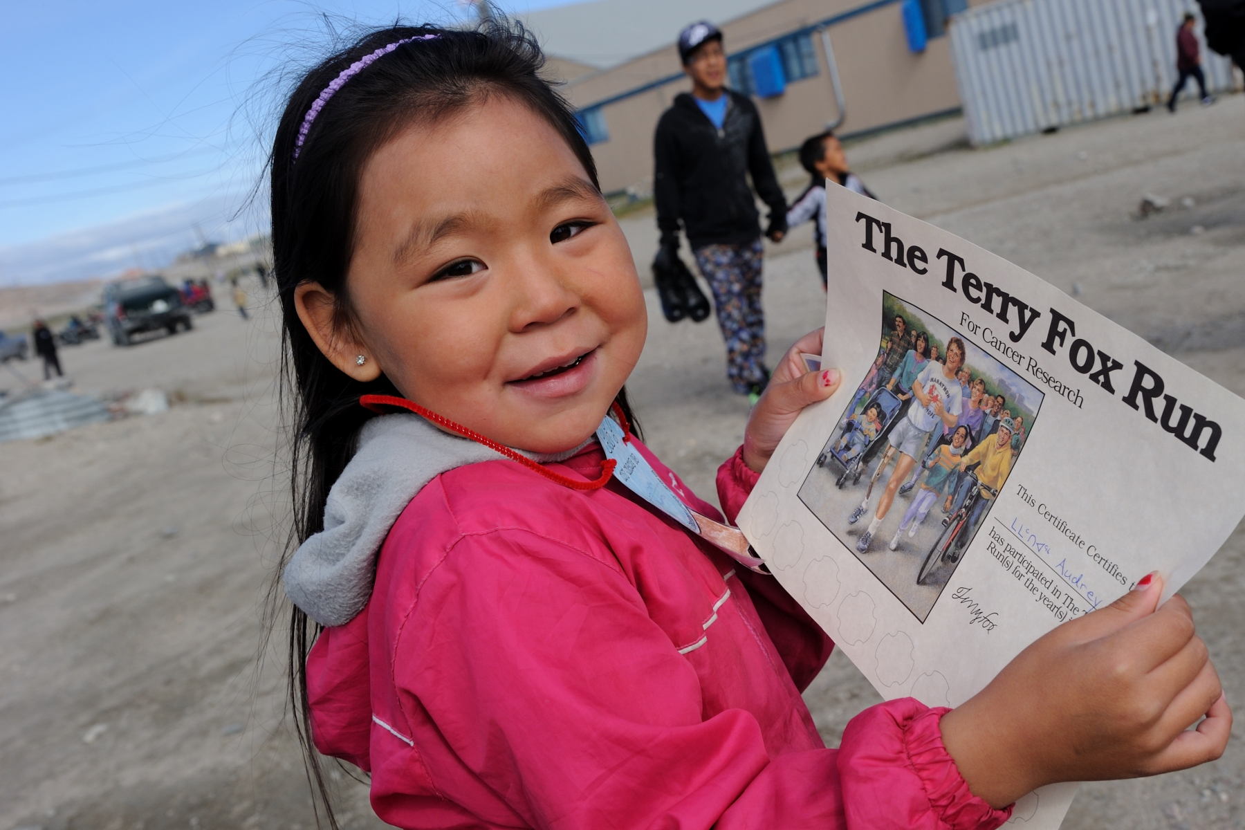 Audrey, a young student at the Tusarvik School, received a certificate for her participation in the Terry Fox School Run.