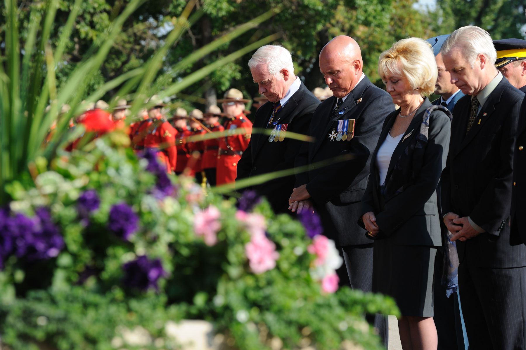 After laying a wreath at the Memorial Wall, the Governor General and other officials honoured fallen members with a minute of silence.