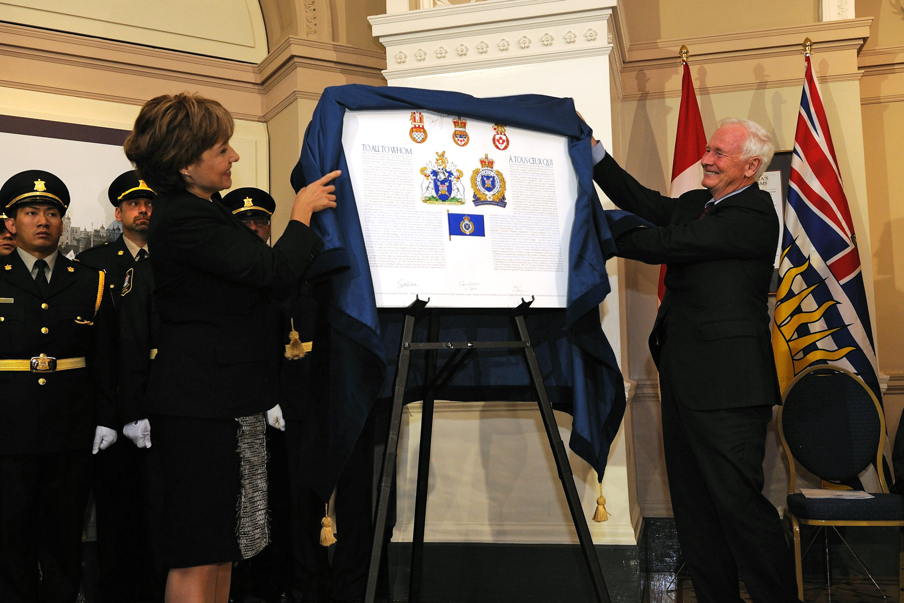 His Excellency with the assistance of the Honourable Christie Clark, Premier of British Columbia, unveiled the coat of arms to the B.C. Sheriff Services.