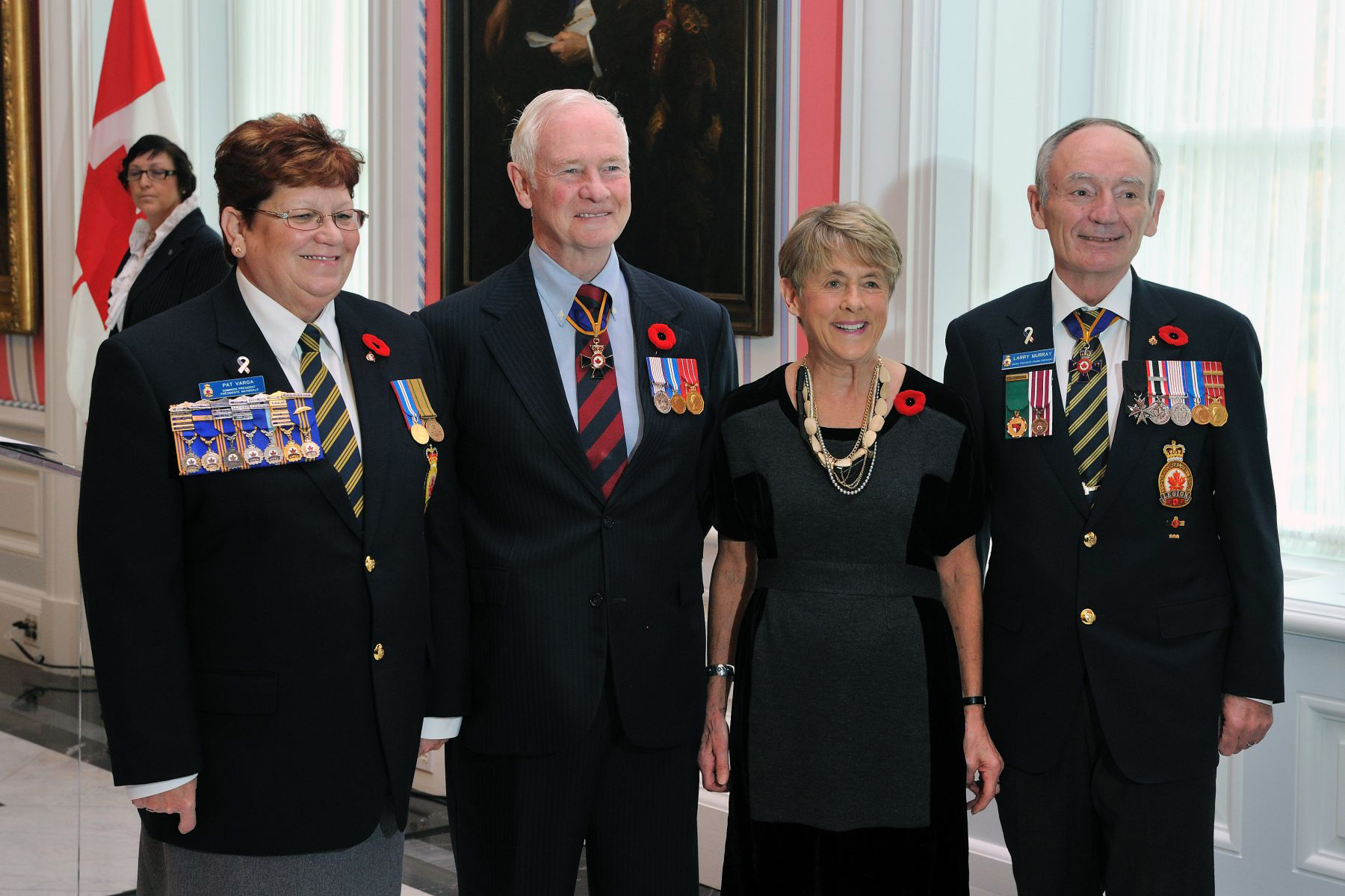 Their Excellencies are pictured with Patricia Varga, Dominion President of The Royal Canadian Legion (left), and Vice-Admiral (Retired) Larry Murray, grand president of The Royal Canadian Legion (right).