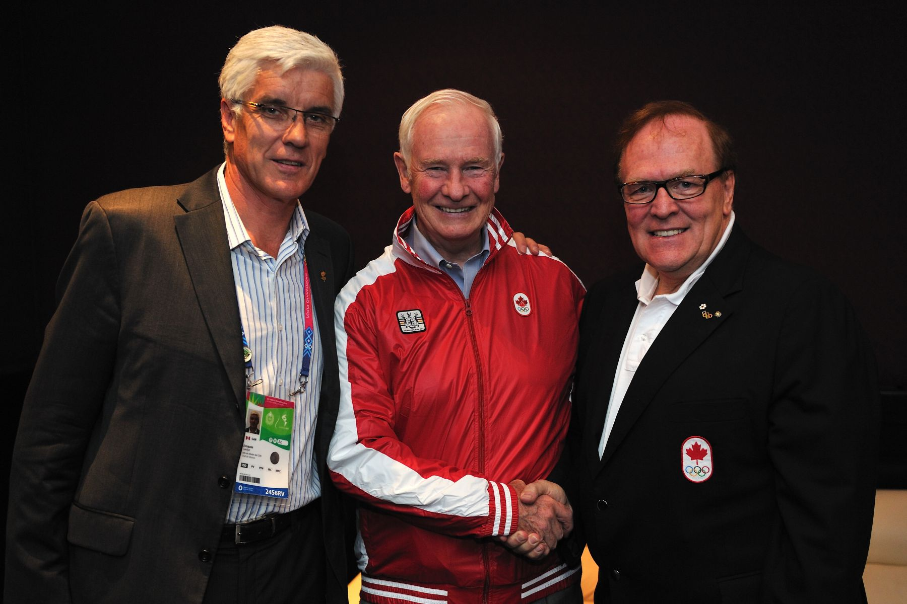 At the request of the Right Honourable Stephen Harper, Prime Minister of Canada, His Excellency the Right Honourable David Johnston, Governor General of Canada, attended the XVI Pan American Games in Guadalajara, Mexico, on October 29 and 30, 2011. Upon his arrival in the city, His Excellency received a Canadian athlete's jacket presented by Mr. Marcel Aubut, President of the Canadian Olympic Committee (right), and Mr. Jacques Cardyn, Chef de Mission of Team Canada (left).