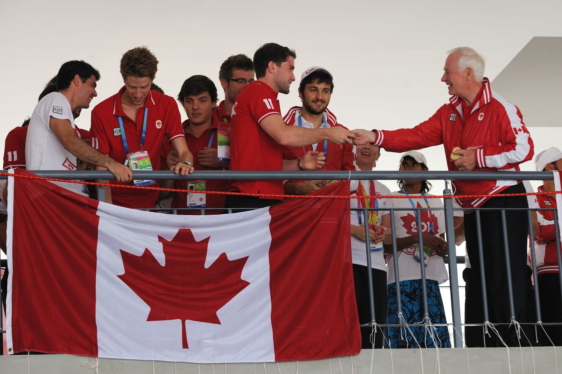 He proudly distributed chocolate medals, a tradition within Team Canada, to athletes who won medals the day before.