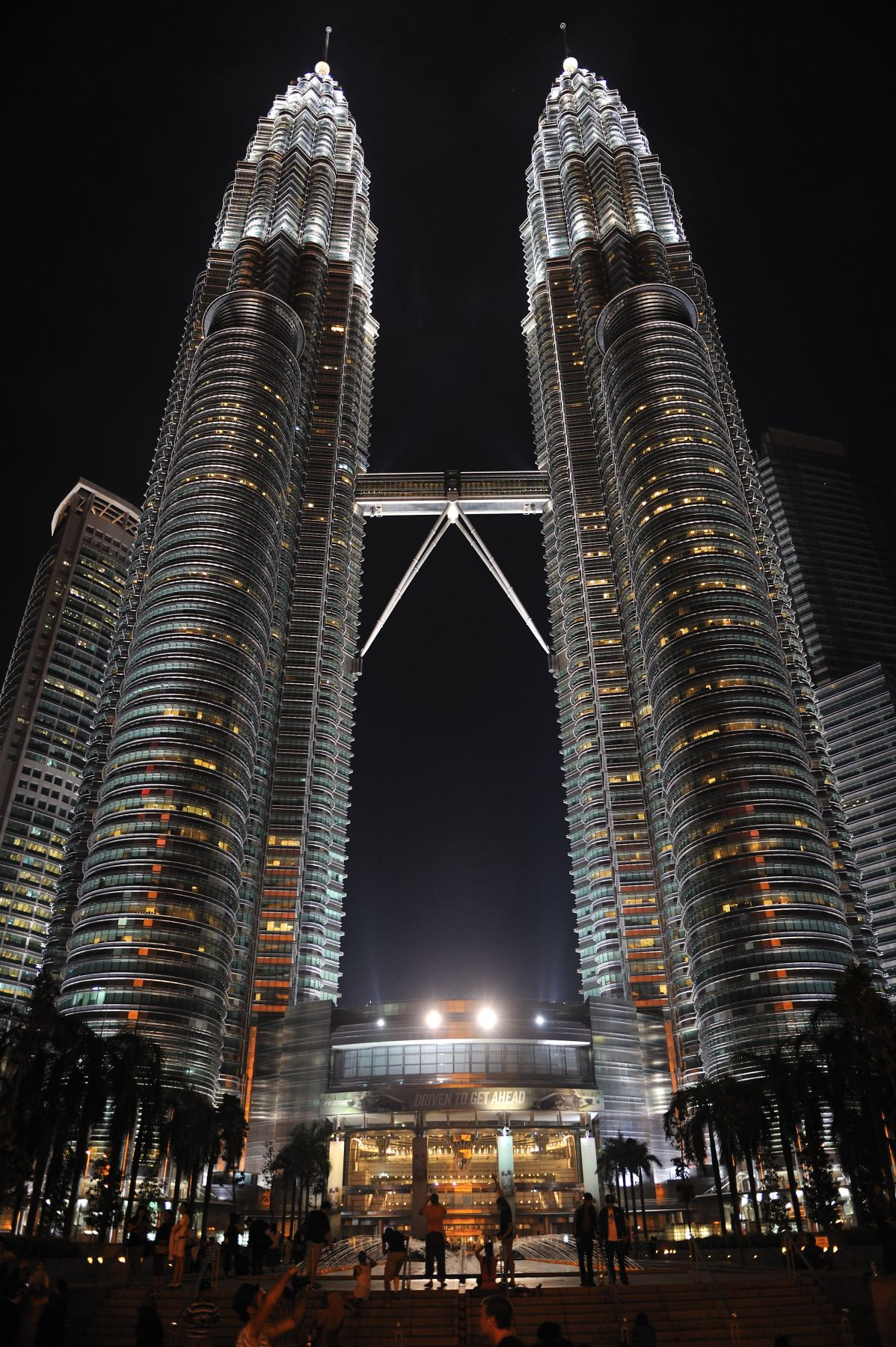 View of the Petronas Towers at night in Kuala Lumpur.