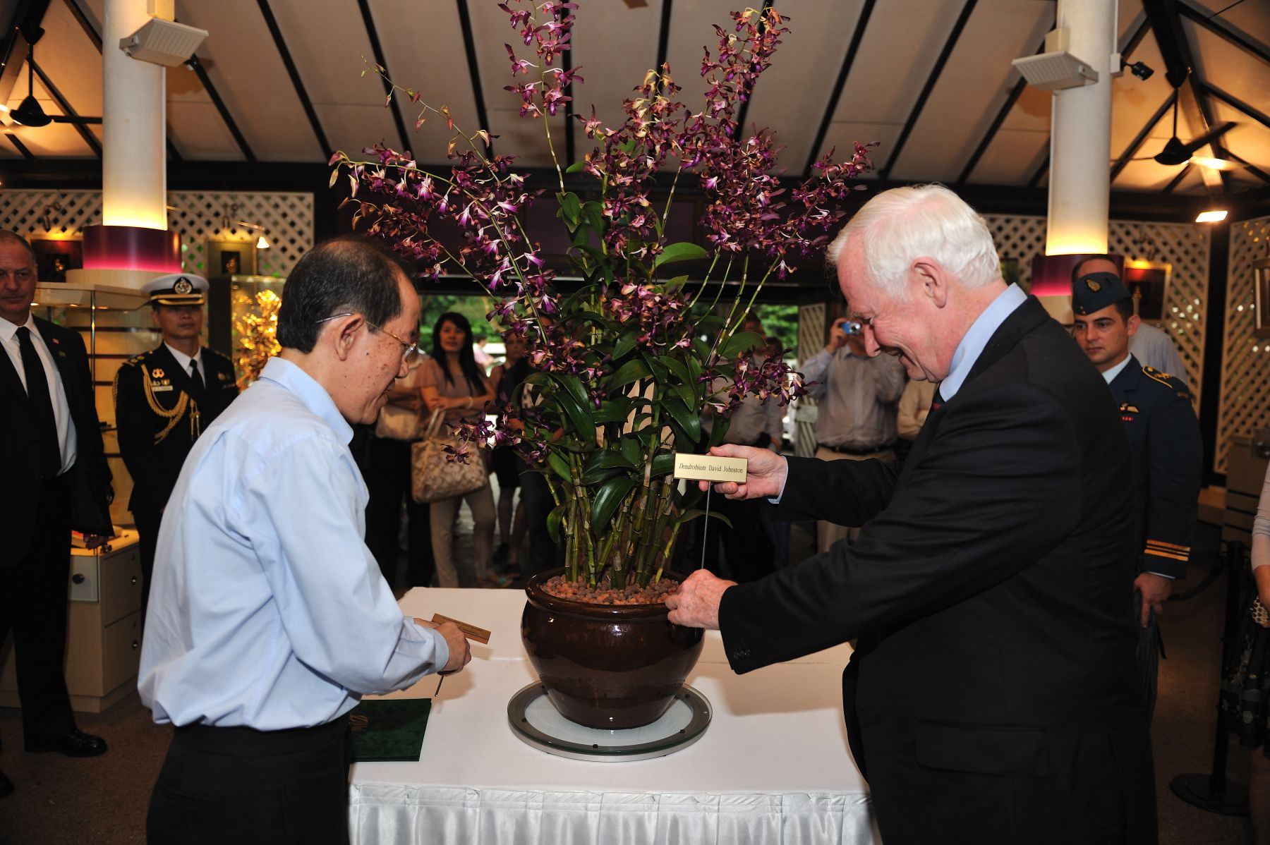 In honour of His Excellency David Johnston's visit to the country, the Government of Singapore named an orchid after him during a ceremony at Singapore's famed National Orchid Garden. His Excellency was presented with the name of the orchid by Dr.Leong Chee Chiew, Deputy Chief Executive Officer and Commissioner of Parks and Recreation.