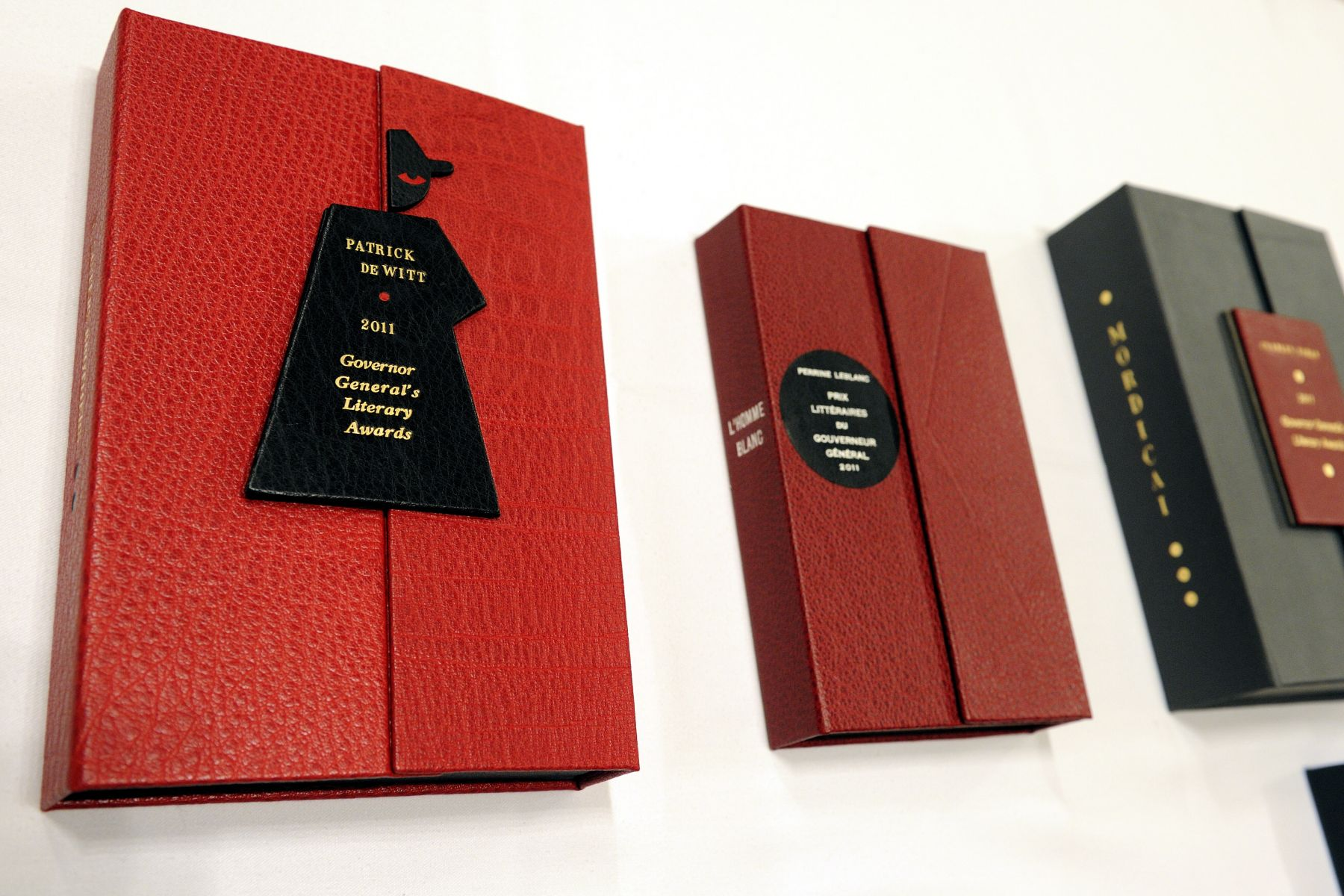 The Governor General's Literary Awards, administered by the Canada Council for the Arts, are Canada's oldest and most prestigious awards for English- and French-language Canadian literature. In addition to the monetary award, each laureate receives a specially-bound copy of the winning book, created by Montreal book-binder Lise Dubois.