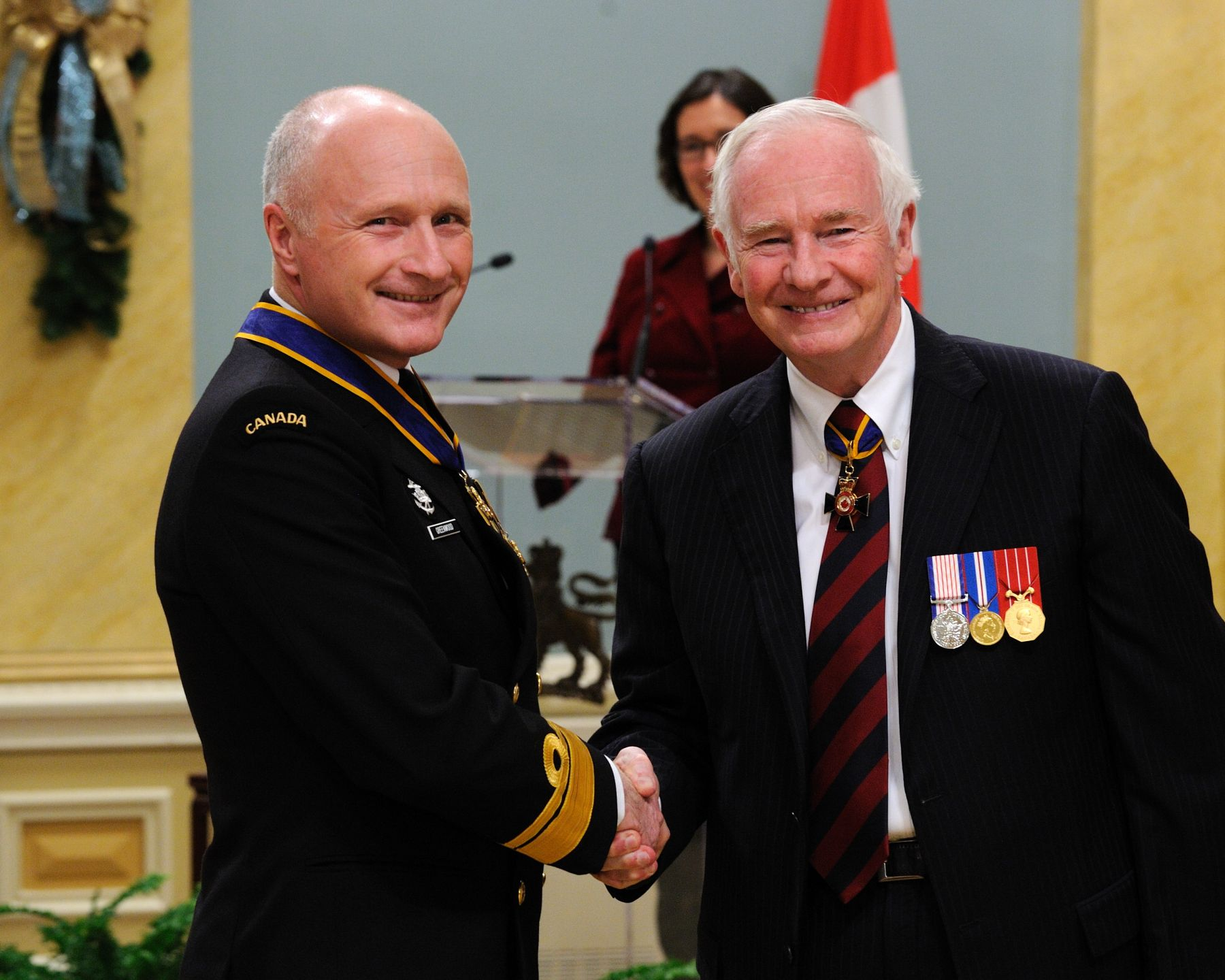 His Excellency presented the Order of Military Merit at the Commander level (C.M.M.) to Rear-Admiral Nigel Stafford Greenwood, C.M.M., C.D., Joint Task Force Pacific Headquarters, Victoria, British Columbia. This is a promotion within the Order.