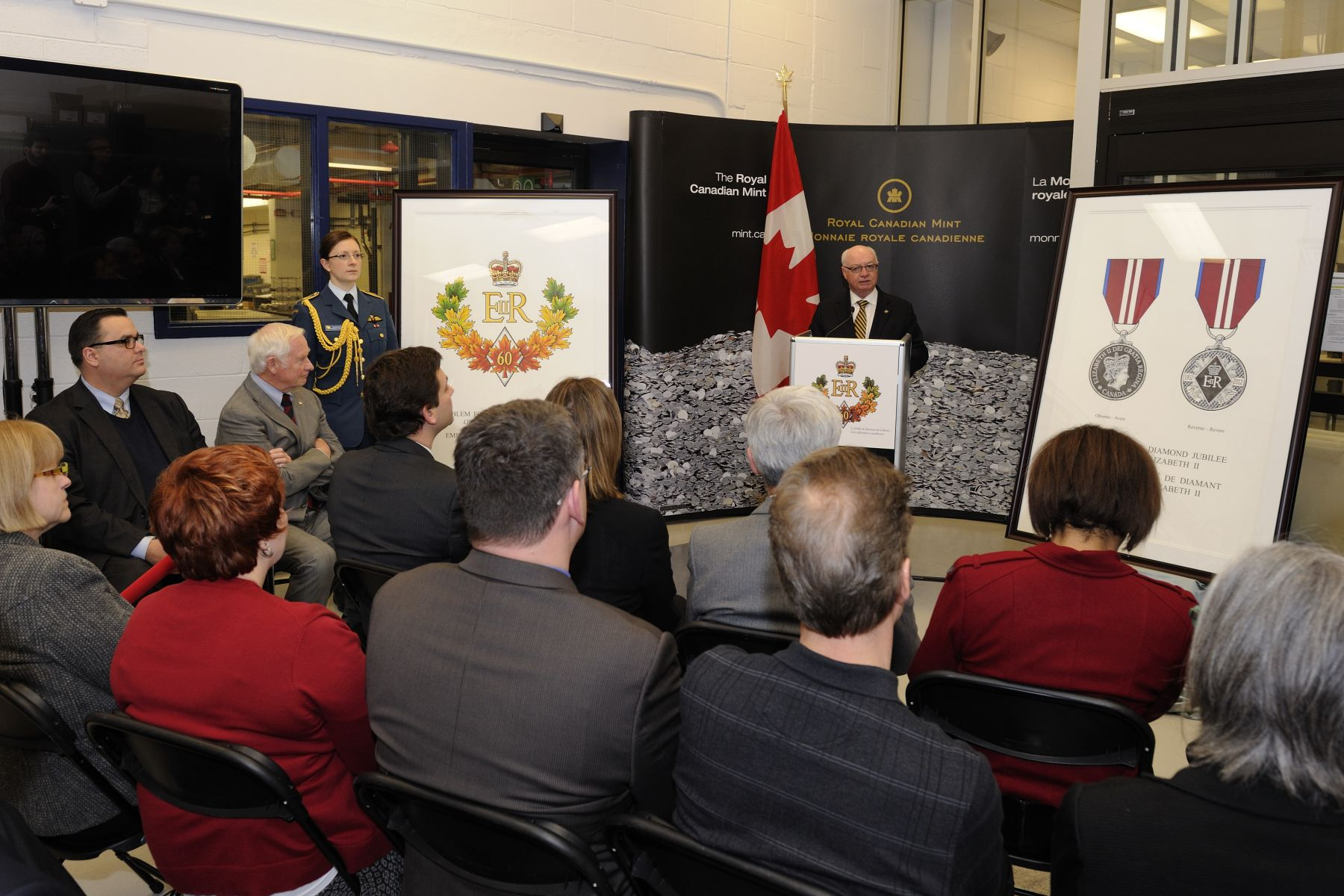 His Excellency participated in a symbolic striking of the Queen Elizabeth II Diamond Jubilee Medal, at the Royal Canadian Mint, in Ottawa. Mr. James B. Love, Chair of the Royal Canadian Mint Board of Directors, welcomed guests to this special event.