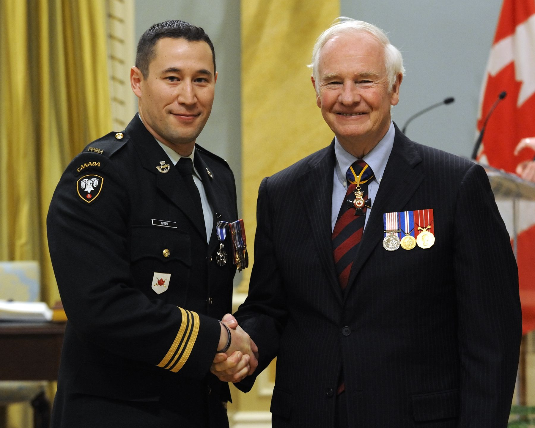 Major Wayne Kenneth Niven, M.S.M., C.D., received the Meritorious Service Medal (Military Division) from His Excellency. As officer commanding Delta Company from October 2009 to May 2010, Major Niven distinguished himself as a first-rate combat leader. Tasked with securing the volatile Nakhonay village, he worked with his Afghan counterpart to clear and hold the area. His ability to work effectively with Afghan officials influenced village elders who were initially resistant to security initiatives. An astute and skilful officer who fully embraced counter-insurgency doctrine, Major Niven and his superb leadership were critical to the battle group's operational success.