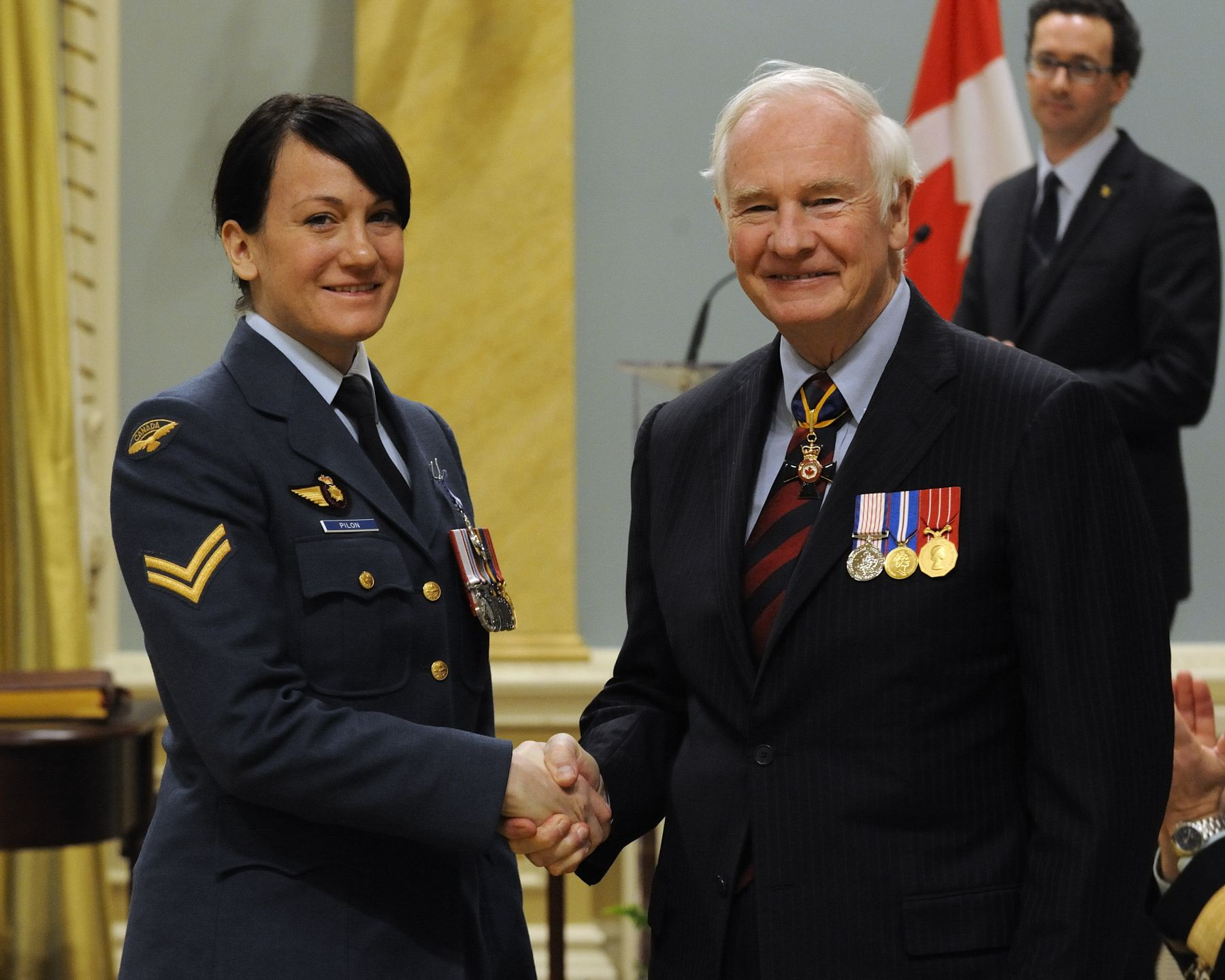 Corporal Emelie Pilon, M.S.M., received the Meritorious Service Medal (Military Division) from His Excellency. In response to the devastating earthquake in Haiti, Captain Desjardins, Corporal Beauclair and Corporal Pilon were sent as part of the inaugural deployment of the Canadian Forces Urban Search and Rescue team, from January to March 2010. Tasked with locating, extracting and recovering Canadian and foreign human remains, these three individuals helped to ease the suffering of many families through their unrelenting and compassionate efforts, and were an inspiration to their team and international partners. Despite the mental and physical demands of this horrific and complex operation, they maintained an unwavering dedication that brought great credit to the Canadian Forces and to Canada. Captain Desjardins and Corporal Beauclair received their insignia at an earlier ceremony.