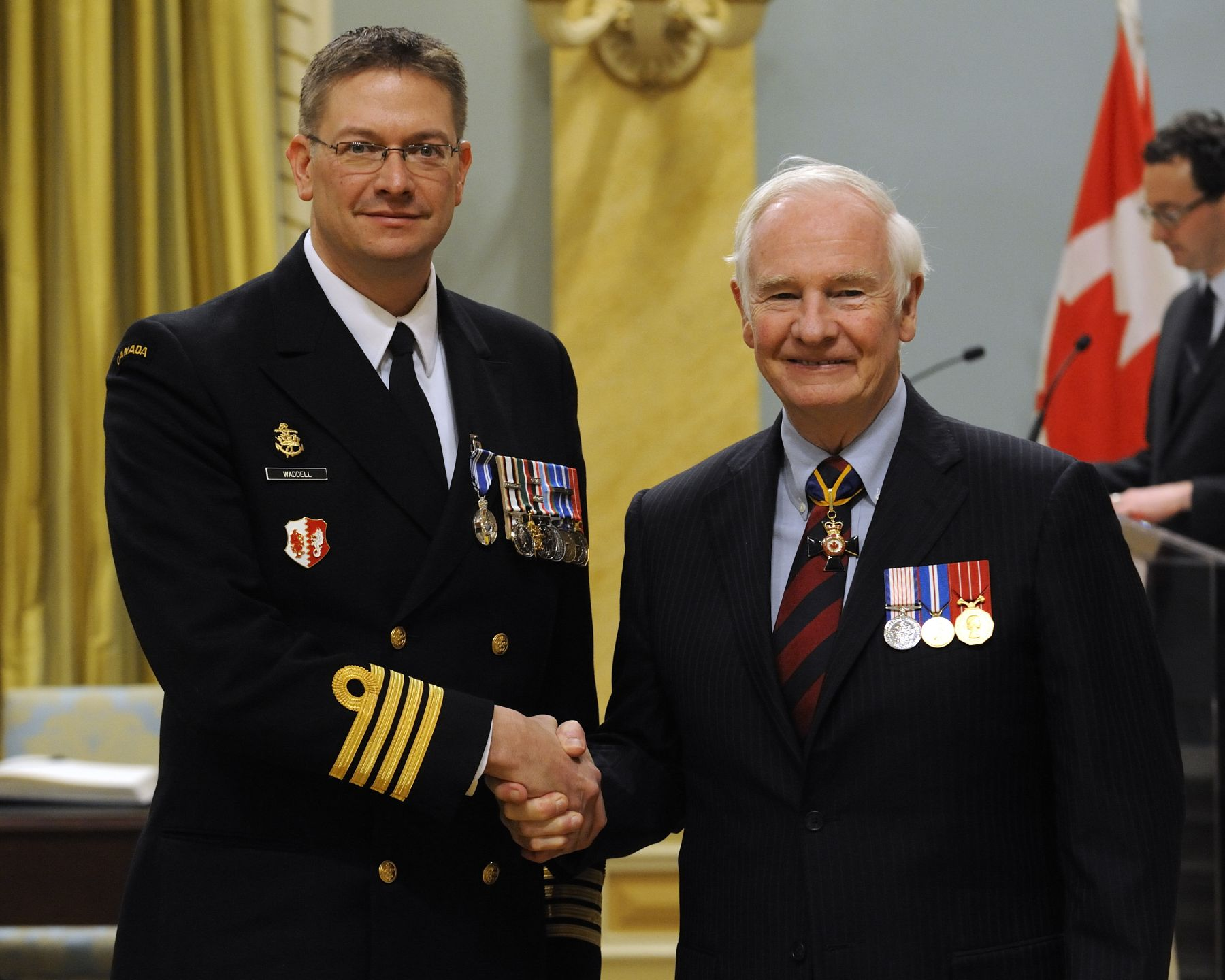 Commander Steven Michael Waddell, M.S.M., C.D., received the Meritorious Service Medal (Military Division) from His Excellency. Commander Waddell served with distinction from October 2009 to May 2010, commanding officer of Her Majesty's Canadian Ship Fredericton and commander of Task Force Saiph, deployed to the Gulf of Aden and the Arabian Sea in support of international counter-piracy and counter-terror efforts. Commander Waddell demonstrated tactical awareness, leadership, operational focus and a humanitarian approach to operations, allowing him to successfully lead his team through challenging missions, which brought great credit to the Royal Canadian Navy and to Canada.