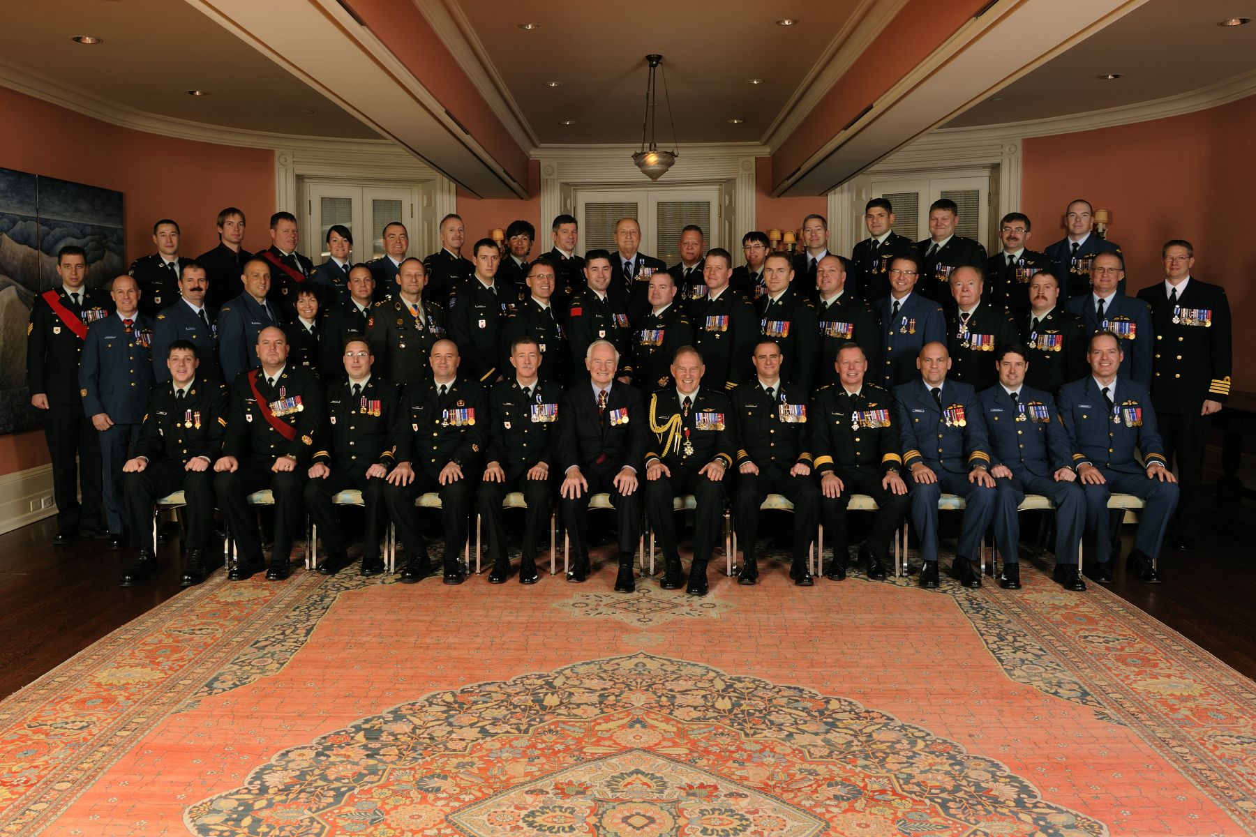 His Excellency the Right Honourable David Johnston, Governor General of Canada, and General Walt Natynczyk, Chief of the Defence Staff, are pictured with the 45 recipients who were presented with military decorations.
