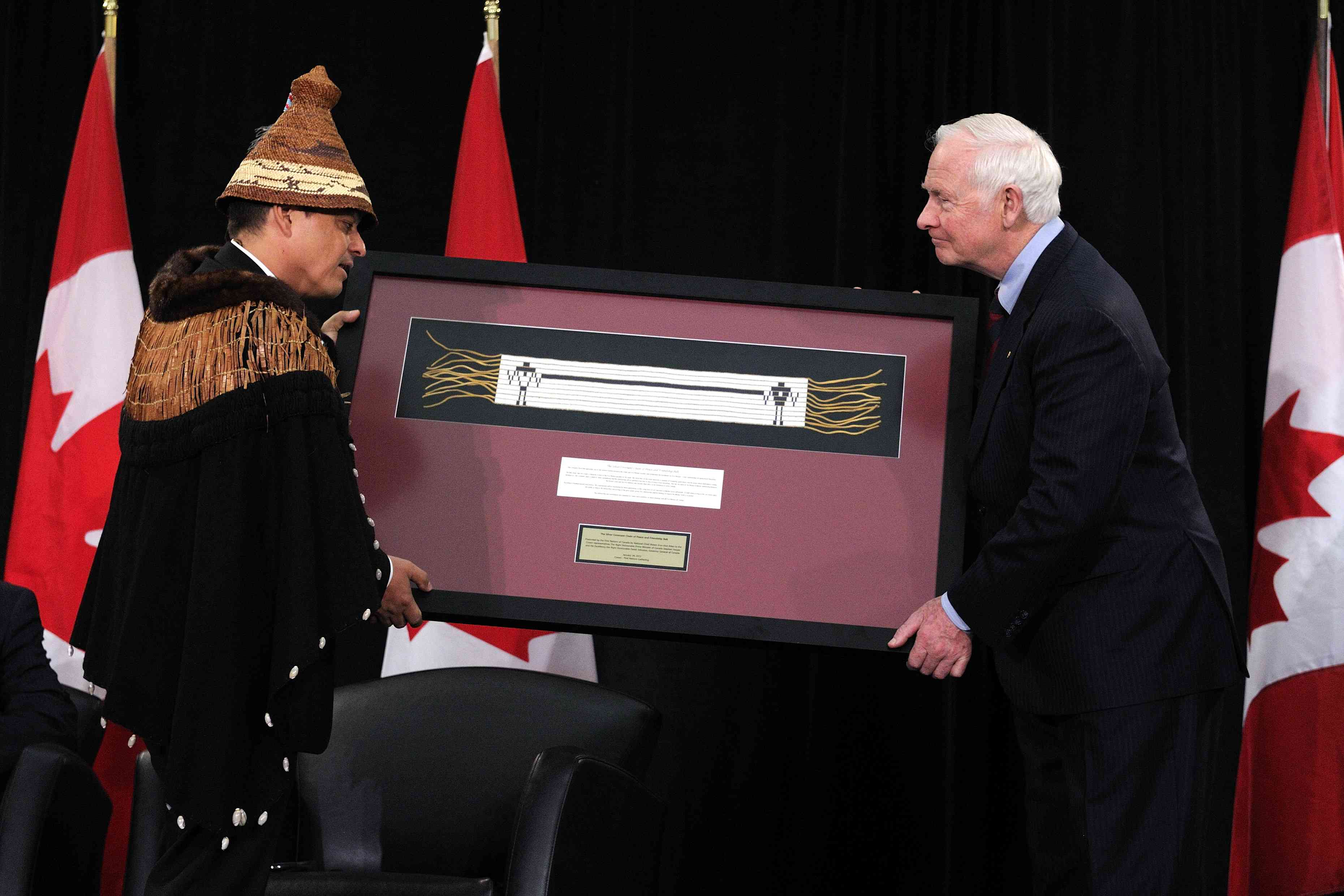 Chief Shawn Atleo exchange gifts with the Governor General. Chief Atleo offered a framed wampum belt on behalf of the Assembly of First Nations.