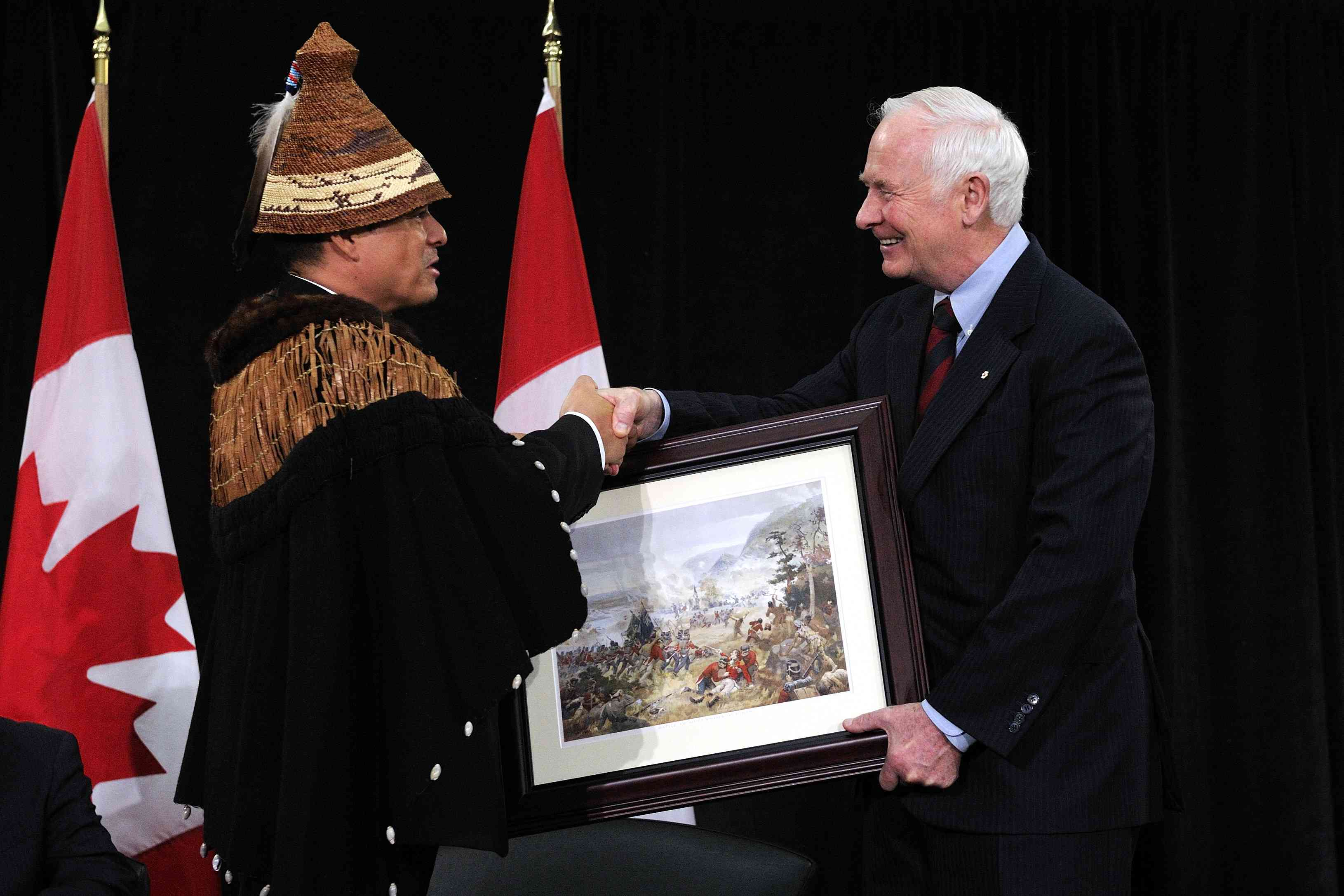 On behalf of the Crown, the Governor General offered a framed painting of the Battle of Queenston Heights to Chief Atleo.