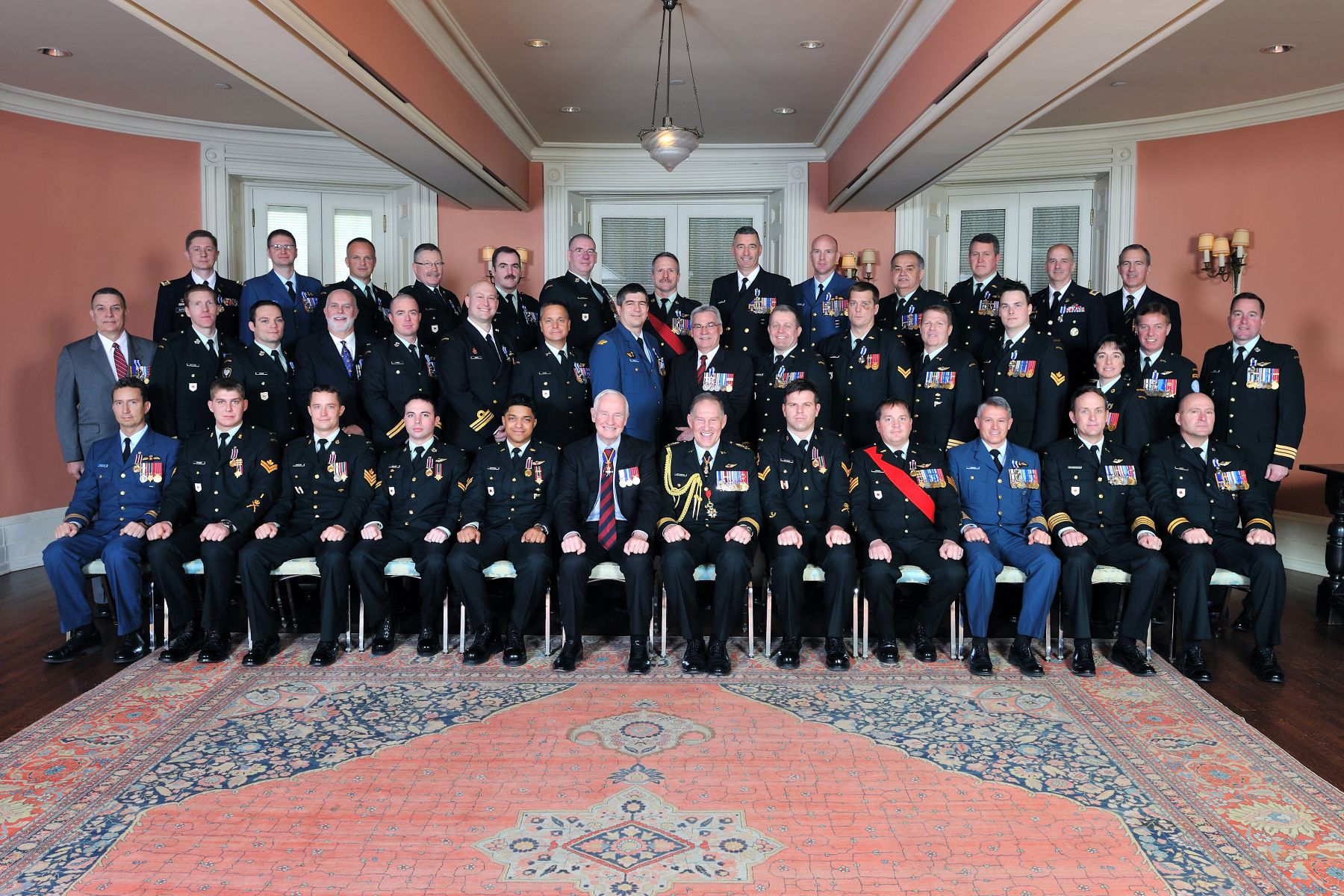 His Excellency the Right Honourable David Johnston, Governor General of Canada, and General Walt Natynczyk, Chief of the Defence Staff, are pictured with the 39 recipients who were presented with military decorations.
