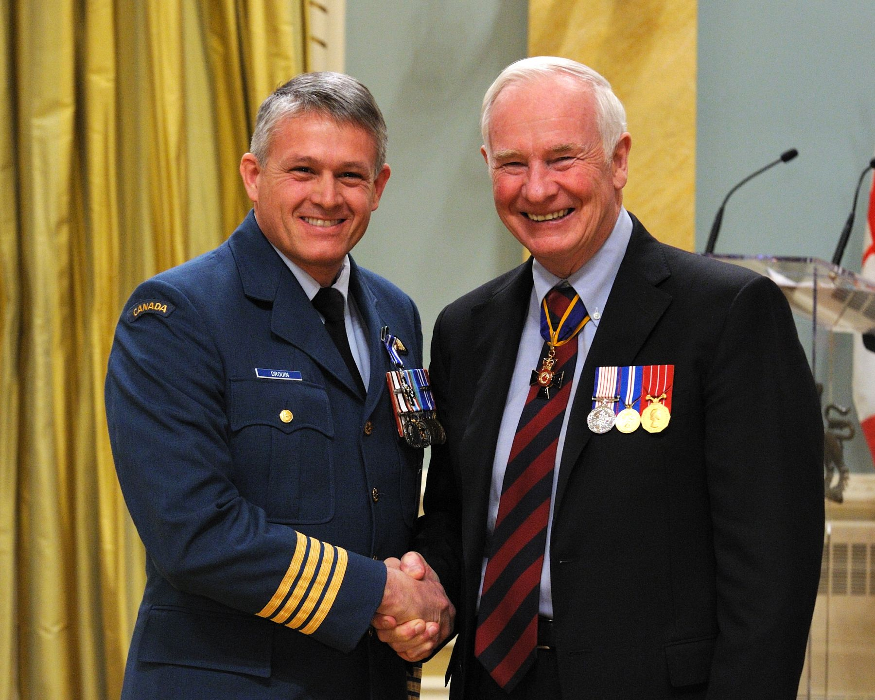 Colonel Christian Drouin, M.S.C., C.D., received the Meritorious Service Cross (Military Division) from His Excellency. As commander of the Air Wing in Afghanistan from November 2009 to September 2010, Colonel Drouin was instrumental in developing the squadron's capability so that it could fully support operations. While promoting the strength of combat aviation to an unprecedented degree, he ensured Canada's leadership within several multinational operations, including one of the largest airmobile operations in the history of Canada's efforts in Afghanistan. Colonel Drouin is a first-rate leader and innovator, and his outstanding command was pivotal to operational success.