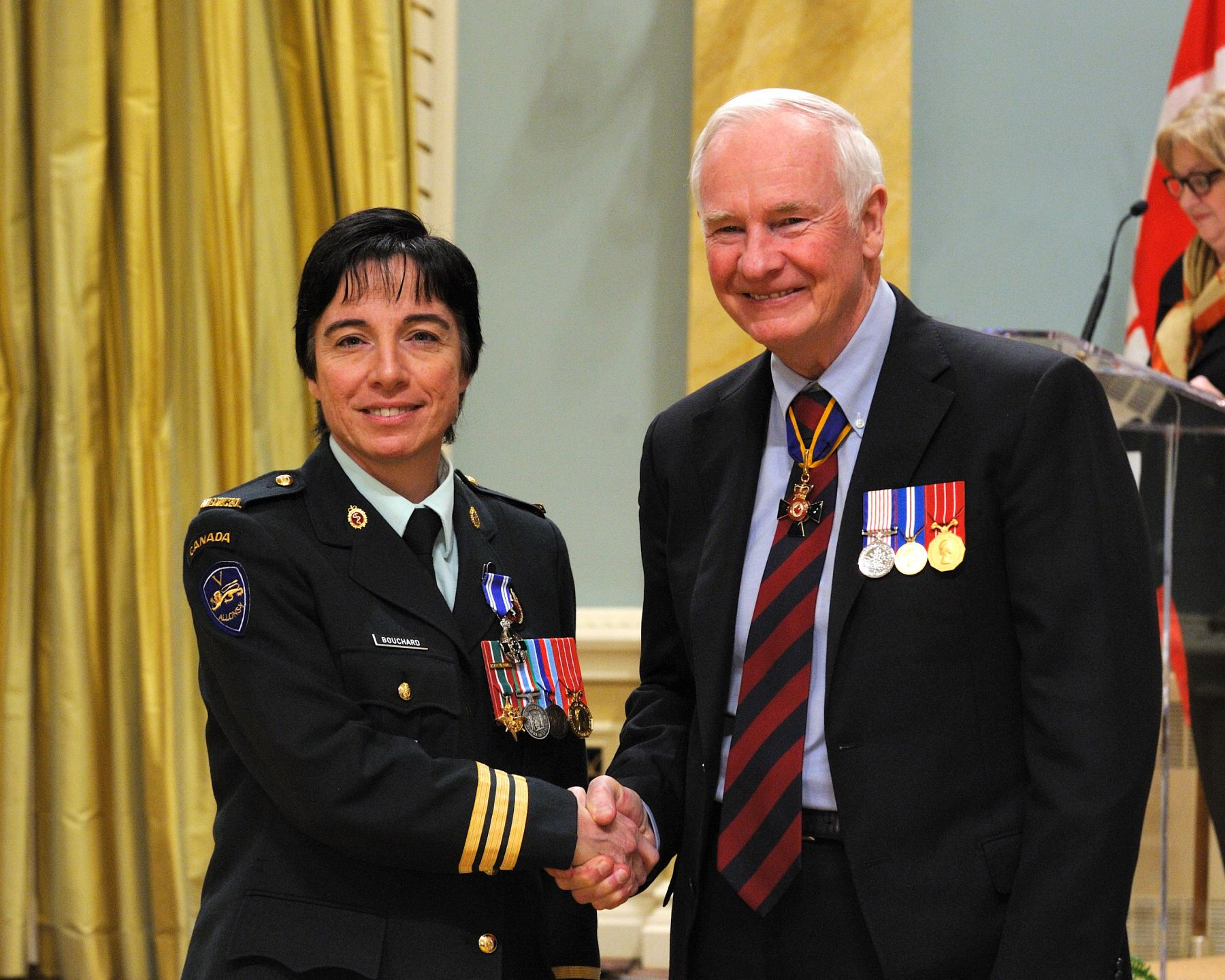 Major Annie Bouchard, M.S.M., C.D., received the Meritorious Service Medal (Military Division) from His Excellency. Following the catastrophic earthquake that struck Haiti in 2010, Major Bouchard, as a first responder, commanded a medical platoon from January to February of that year. Despite the physical and mental challenges of administering medical treatment in such a horrifying environment, she provided critical care to countless wounded, while keeping watch over her team's morale and well-being. 