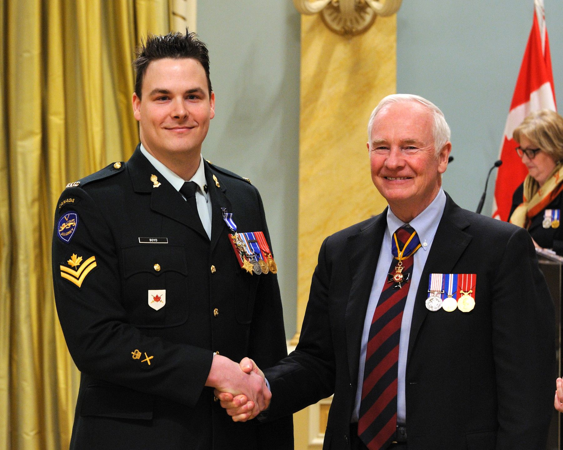 Master Corporal Danny Denis Boyd, M.S.M., C.D., received the Meritorious Service Medal (Military Division) from His Excellency. Master Corporal Boyd's leadership and technical skills greatly improved the efficiency of the Fire Support Coordination Centre within Joint Task Force Afghanistan Headquarters during his deployment from November 2009 to September 2010. In addition to developing a method that enhanced information management, he was selected to brief an American unit on the Centre's procedures, helping them integrate seamlessly into the area of operations. Master Corporal Boyd's dedicated efforts enhanced the Centre's ability to ensure the effective delivery of fire support.