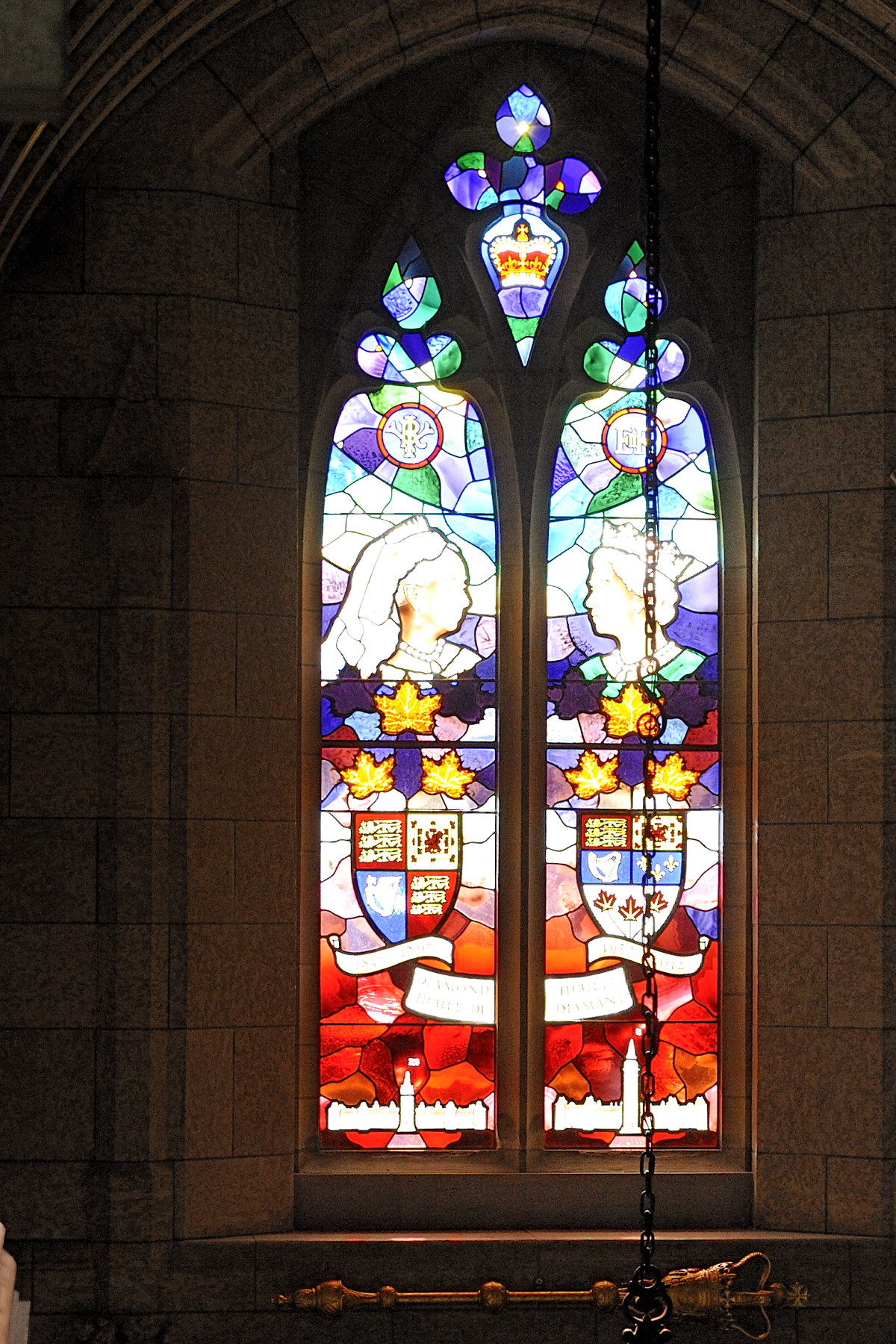 The Diamond Jubilee window was created to celebrate the 60th anniversary of Her Majesty Queen Elizabeth II's reign and to commemorate the Diamond Jubilee of Queen Victoria. It is located over the Senate entrance to the Parliament Buildings.