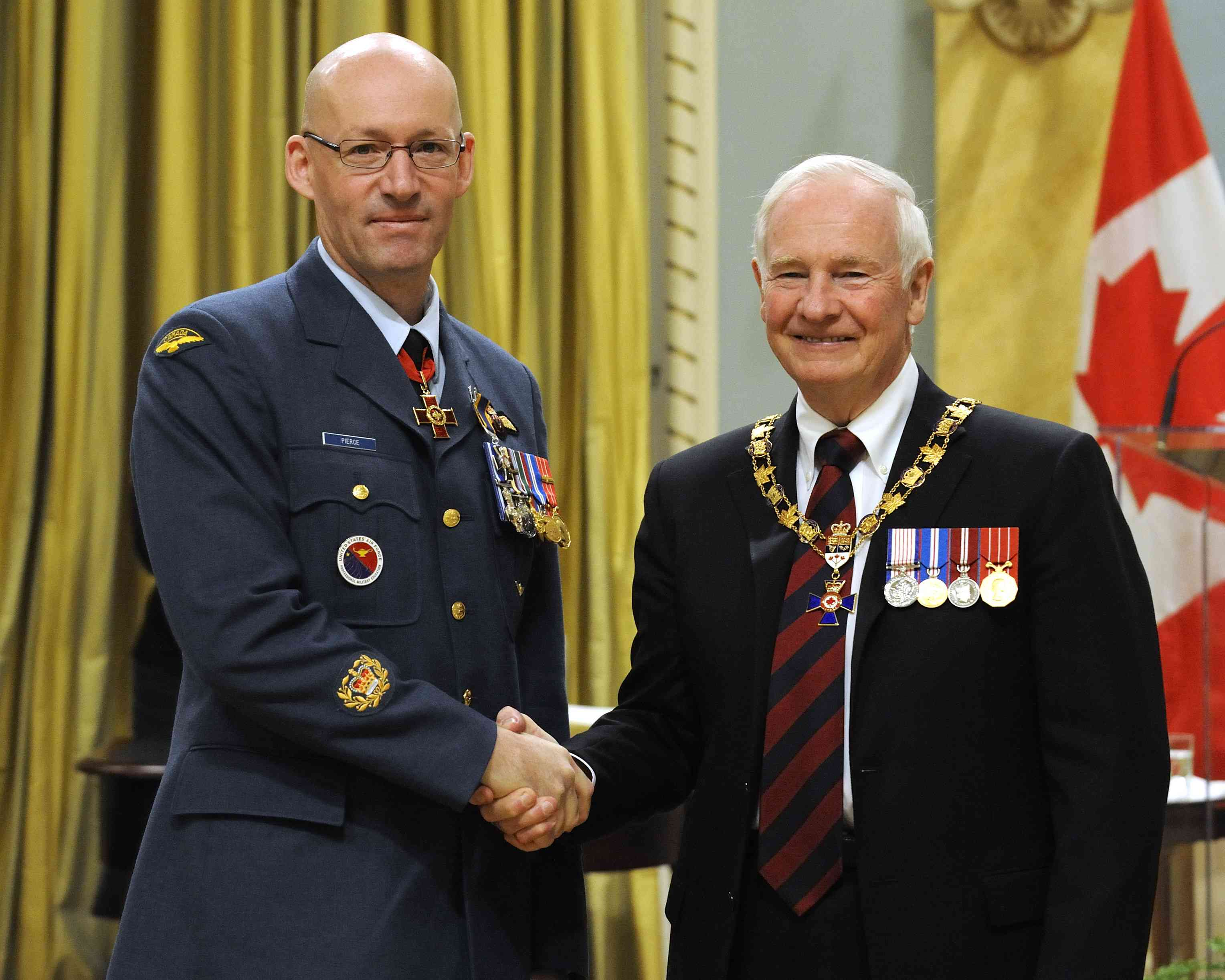 His Excellency presented the Order of Military Merit at the Member level (M.M.M.) to Master Warrant Officer Bryan Pierce, C.V., M.M.M., M.S.C., C.D, Canadian Forces School of Survival and Aeromedical Training, Winnipeg, Man.