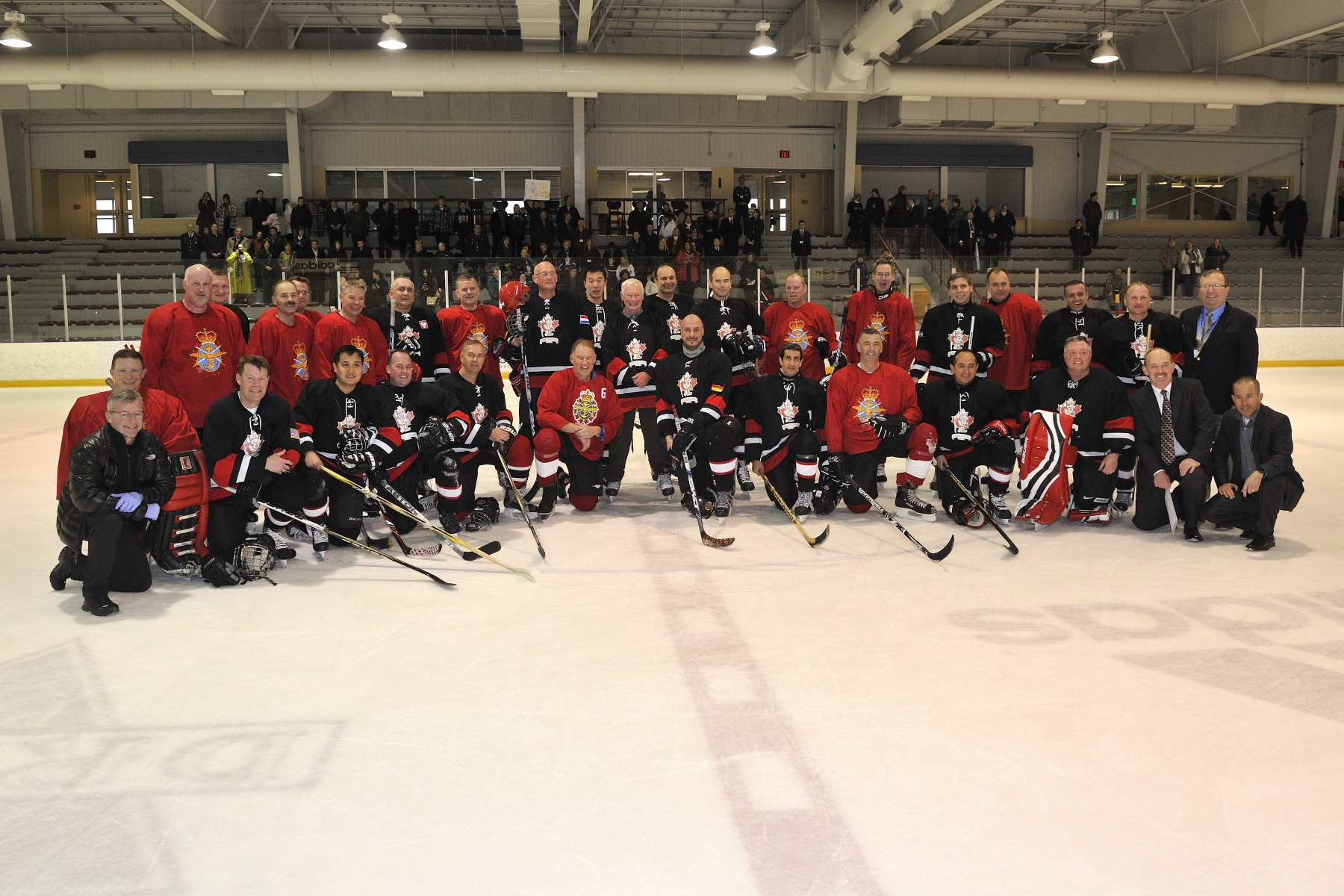 The Governor General and General Walt Natynczyk, Chief of the Defence Staff, are pictured with both teams.