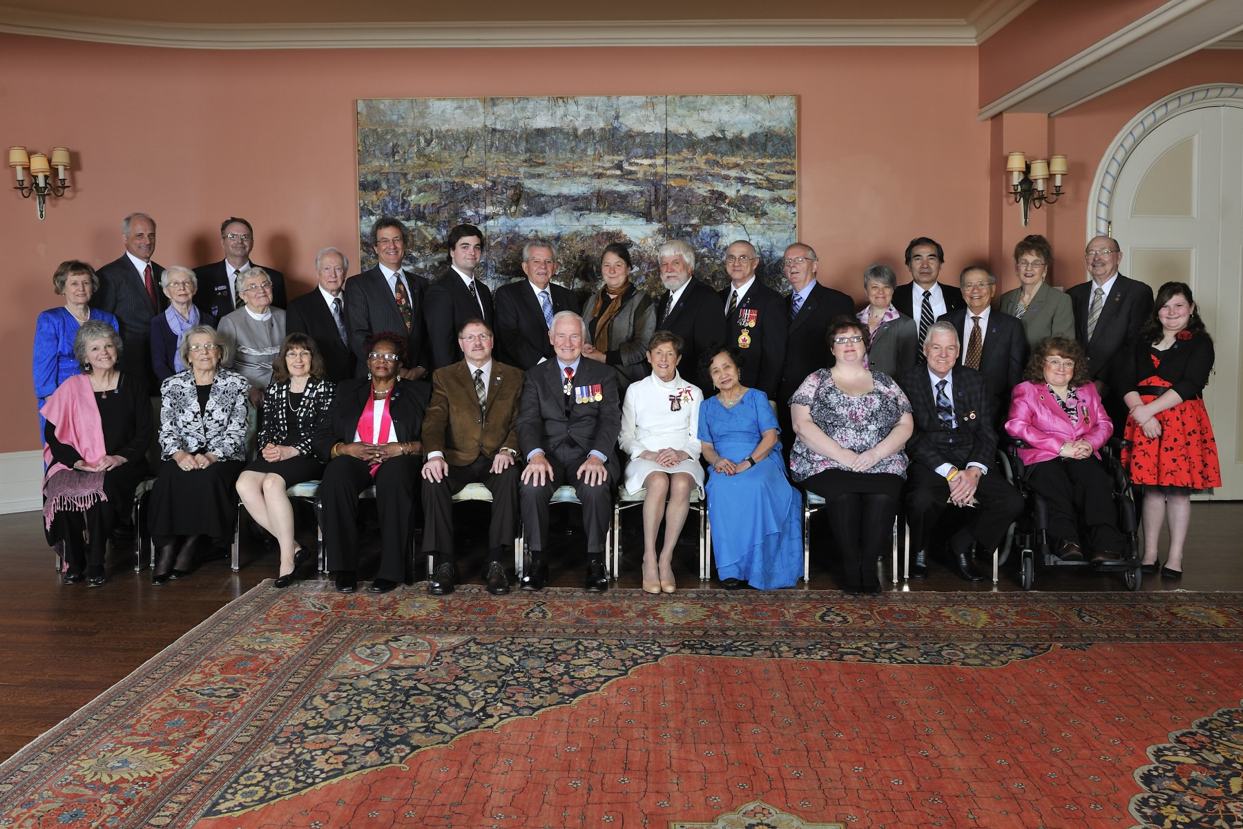 Their Excellencies are pictured with the 28 recipients of the Governor General's Caring Canadian Award, on April 17, 2012.