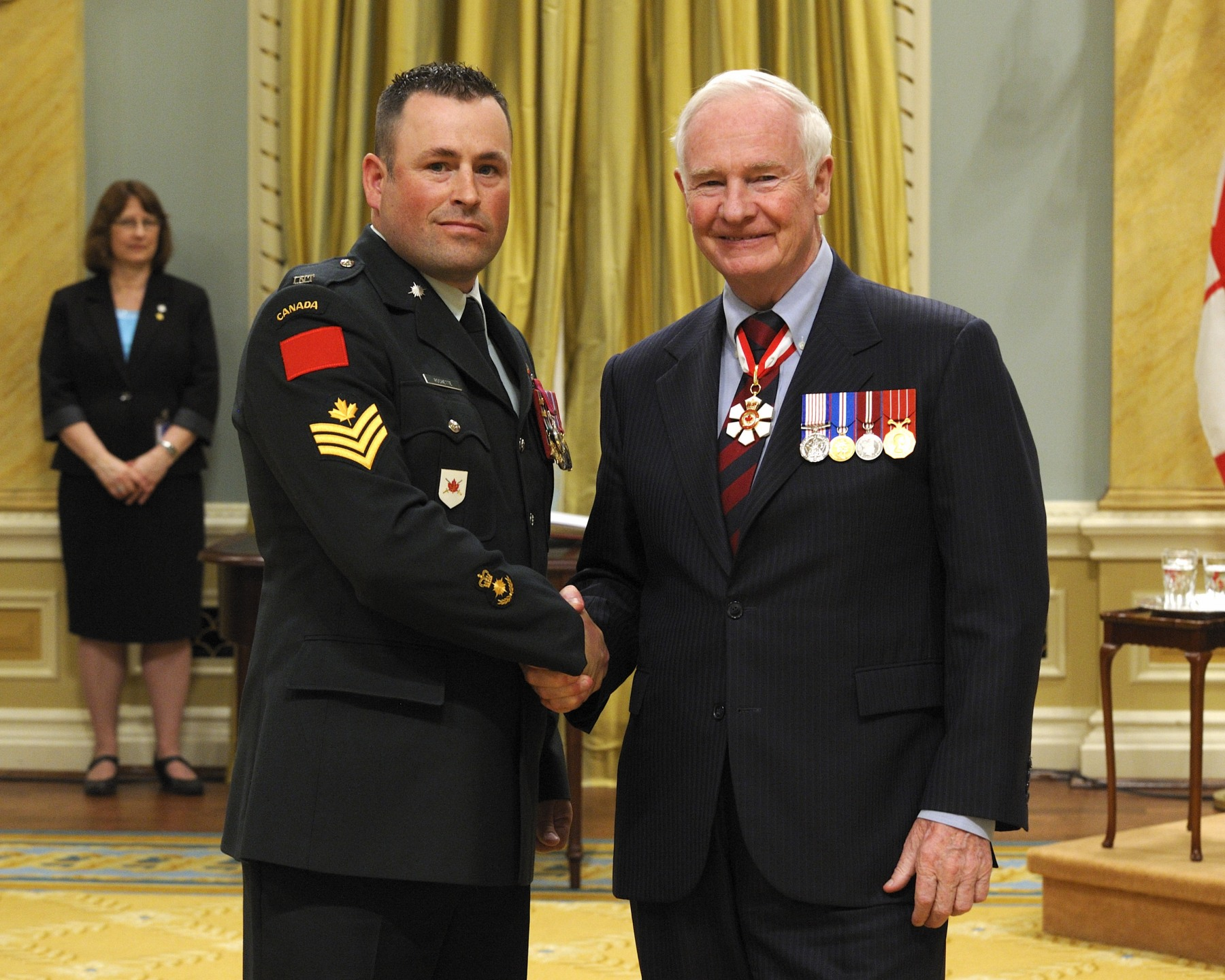 On June 17, 2009, Master Corporal Daniel Rochette, M.B., C.D. (Sudbury and Napanee, Ontario), saved a man from possible drowning in the Jacques-Cartier River, in Pont-Rouge, Quebec. Master Corporal Rochette was fishing with his family when a man, standing near them, fell into the water and was carried off by the river's powerful current. Acting quickly, Master Corporal Rochette jumped in after him, but the strong current made the situation very dangerous for both men. Master Corporal Rochette had to let go and return to the shore, from which he held out a log to the distressed man. After a few attempts, the victim managed to grab on and the rescuer pulled him to shore.