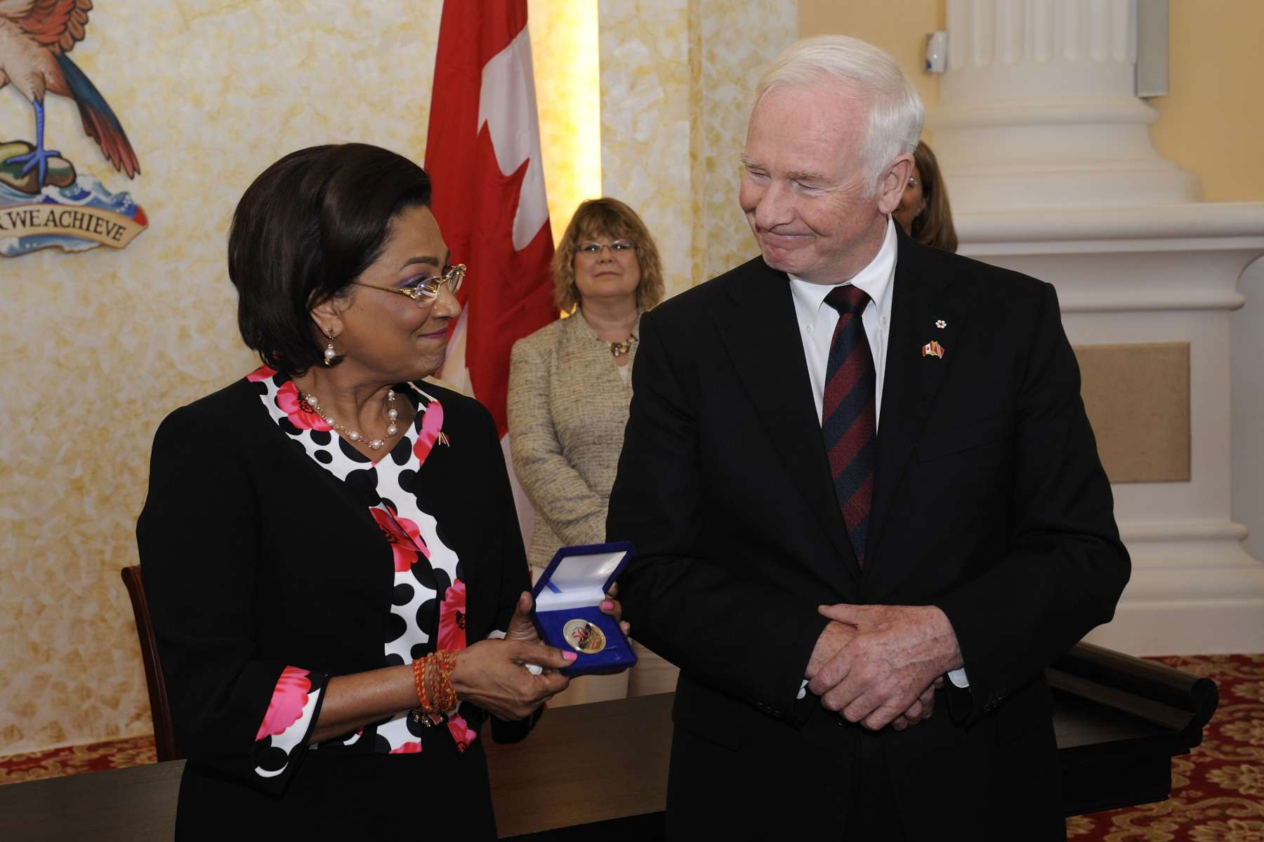 The Governor General presented the Honourable Kamla Persad-Bissessar, Prime Minister of the Republic of Trinidad and Tobago, with a 50th anniversary commemorative coin.