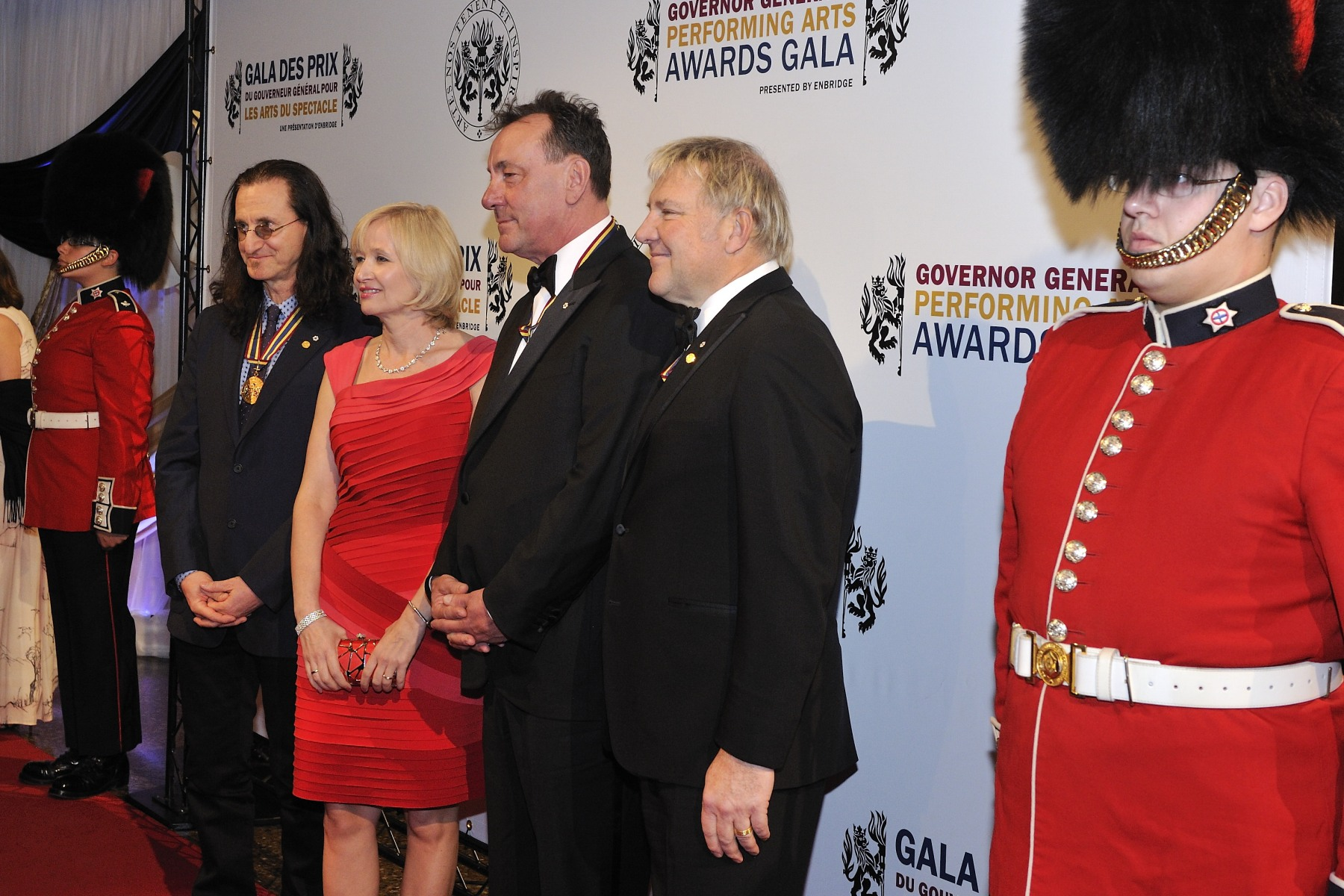 Mrs. Laureen Harper was seen on the red carpet with the members of the rock band Rush, laureates of the 2012 Lifetime Artistic Achievement Awards. The gala