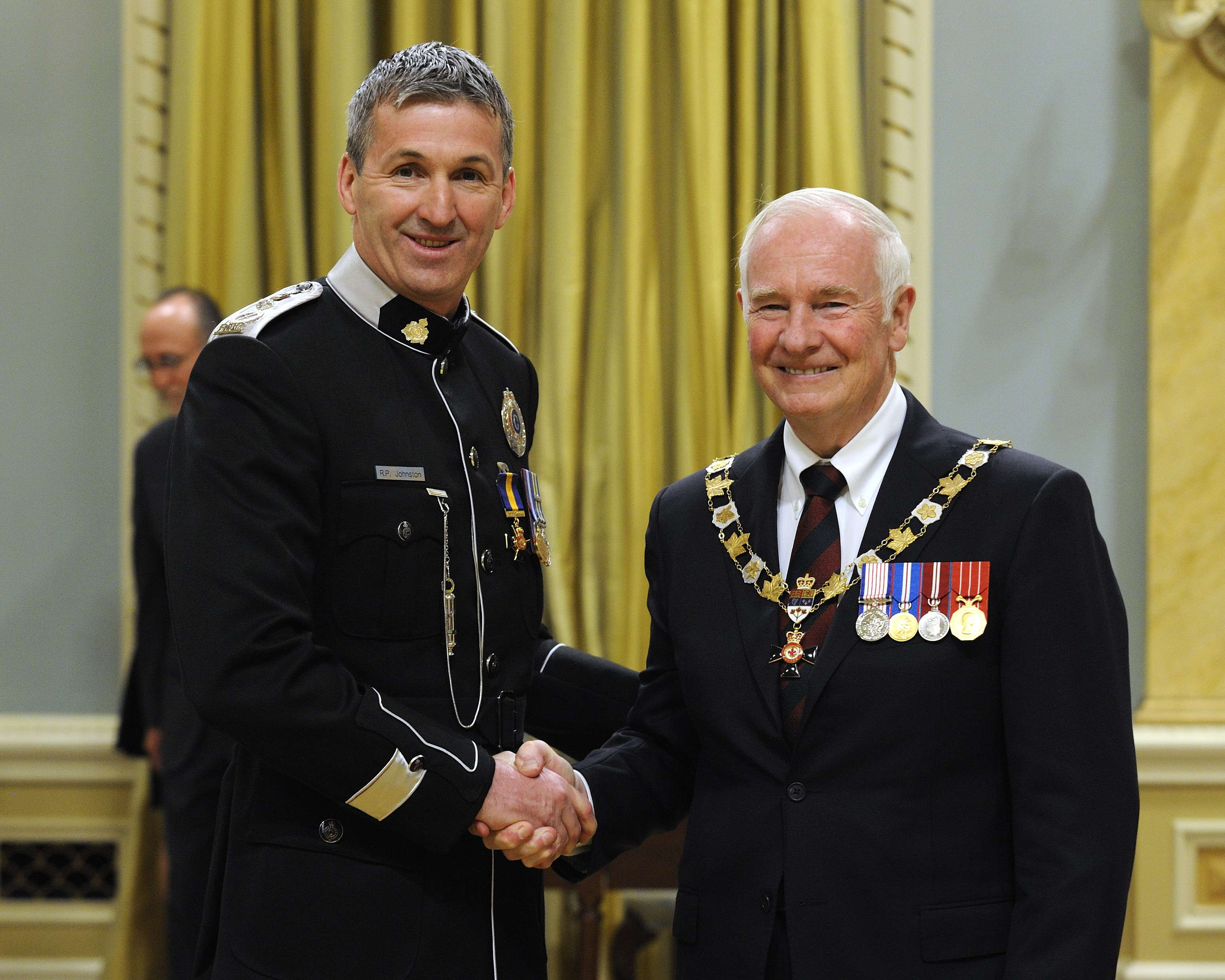 His Excellency presented the Order of Merit of the Police Forces at the Officer level (O.O.M.) to Chief Robert Philip Johnston, O.O.M., of the Royal Newfoundland Constabulary, Newfoundland and Labrador.