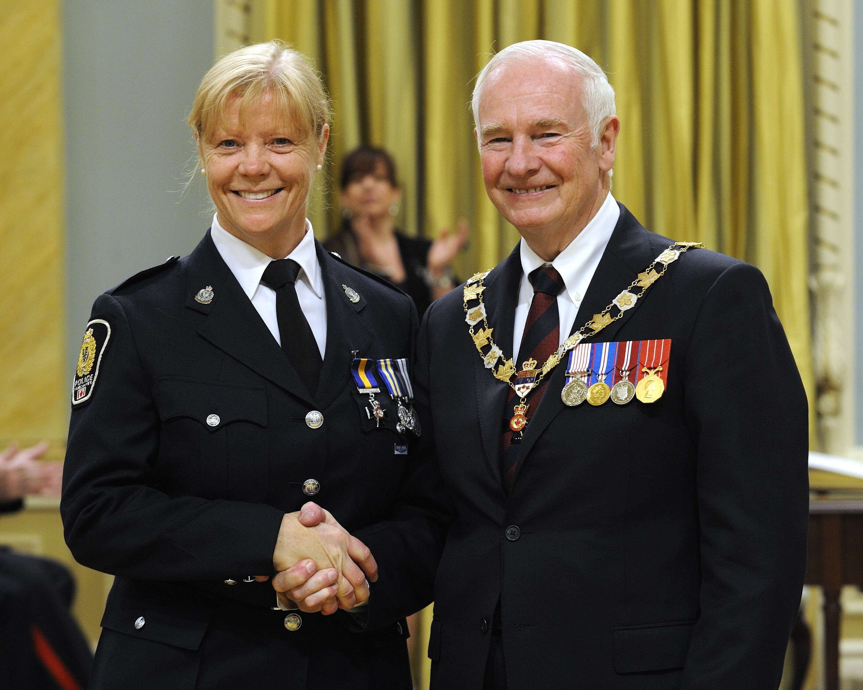 His Excellency presented the Order of Merit of the Police Forces at the Member level (M.O.M.) to Constable Linda A. Malcolm, M.O.M., of the Vancouver Police Department, British Columbia.