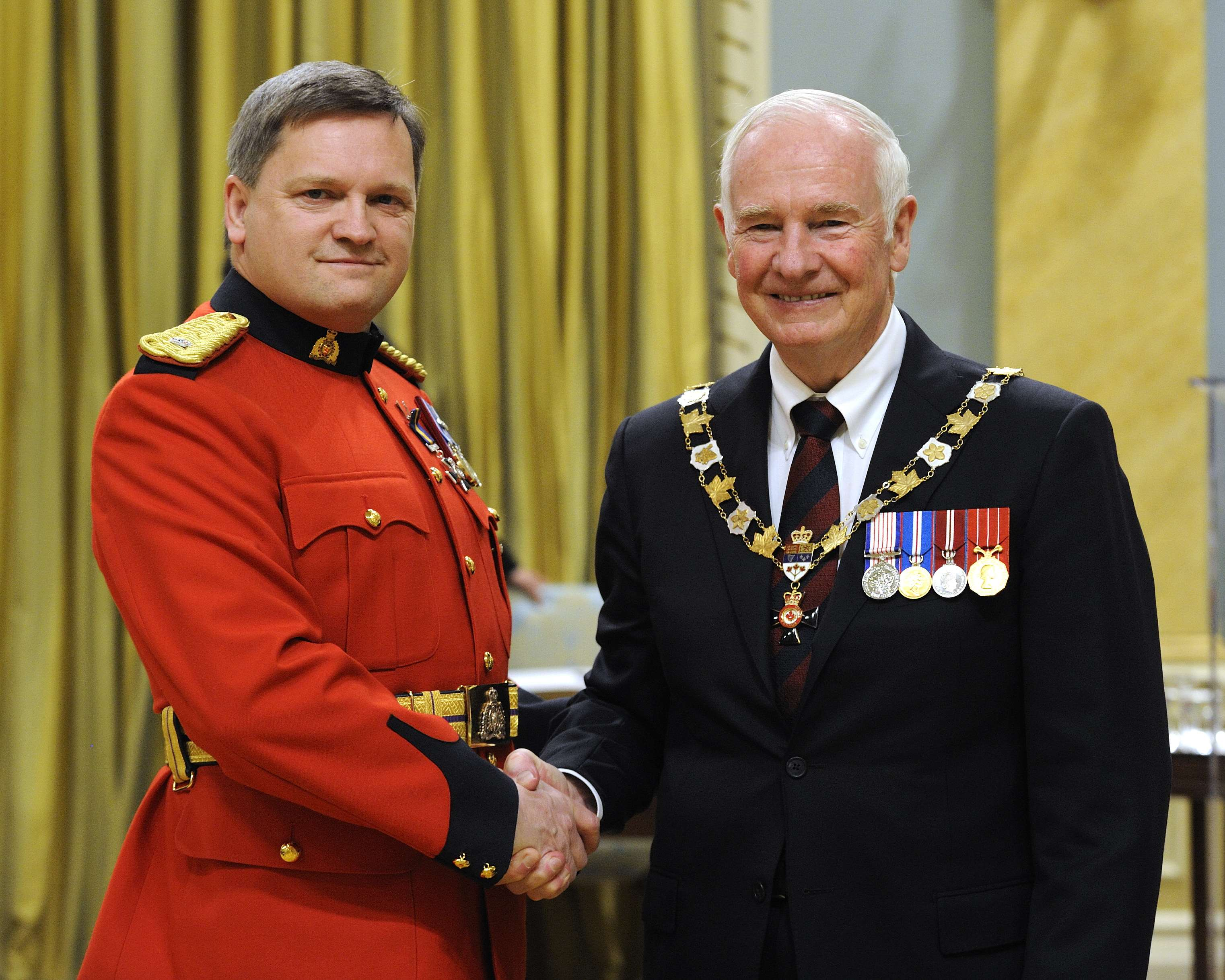 His Excellency presented the Order of Merit of the Police Forces at the Member level (M.O.M.) to Inspector Richard Wayne Votour, M.O.M., of the Royal Canadian Mounted Police, 