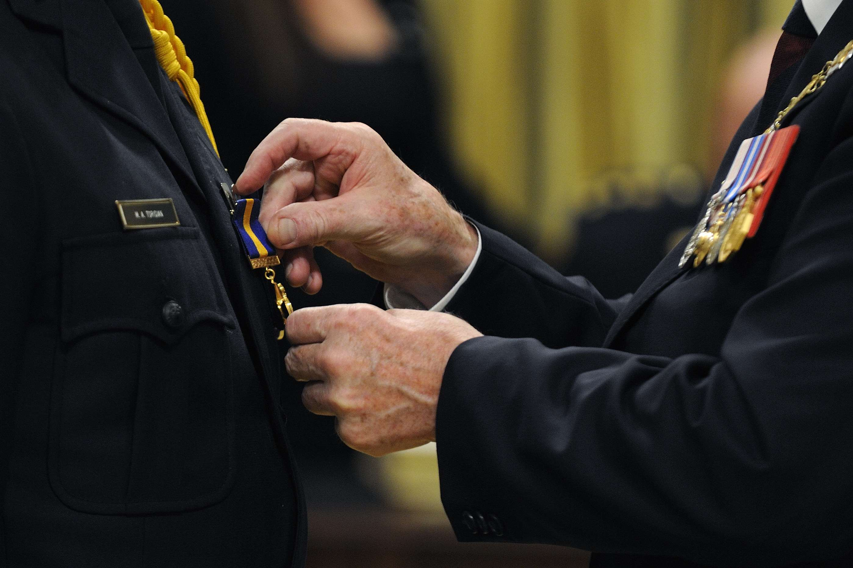 The Order of Merit of the Police Forces was created in 2000, to recognize conspicuous merit and exceptional service by members and employees of the Canadian police forces whose contributions extend beyond protection of the community. Three levels of membership with post-nominal letters reflect long-term, outstanding service: Commander (C.O.M.), Officer (O.O.M.) and Member (M.O.M.).
