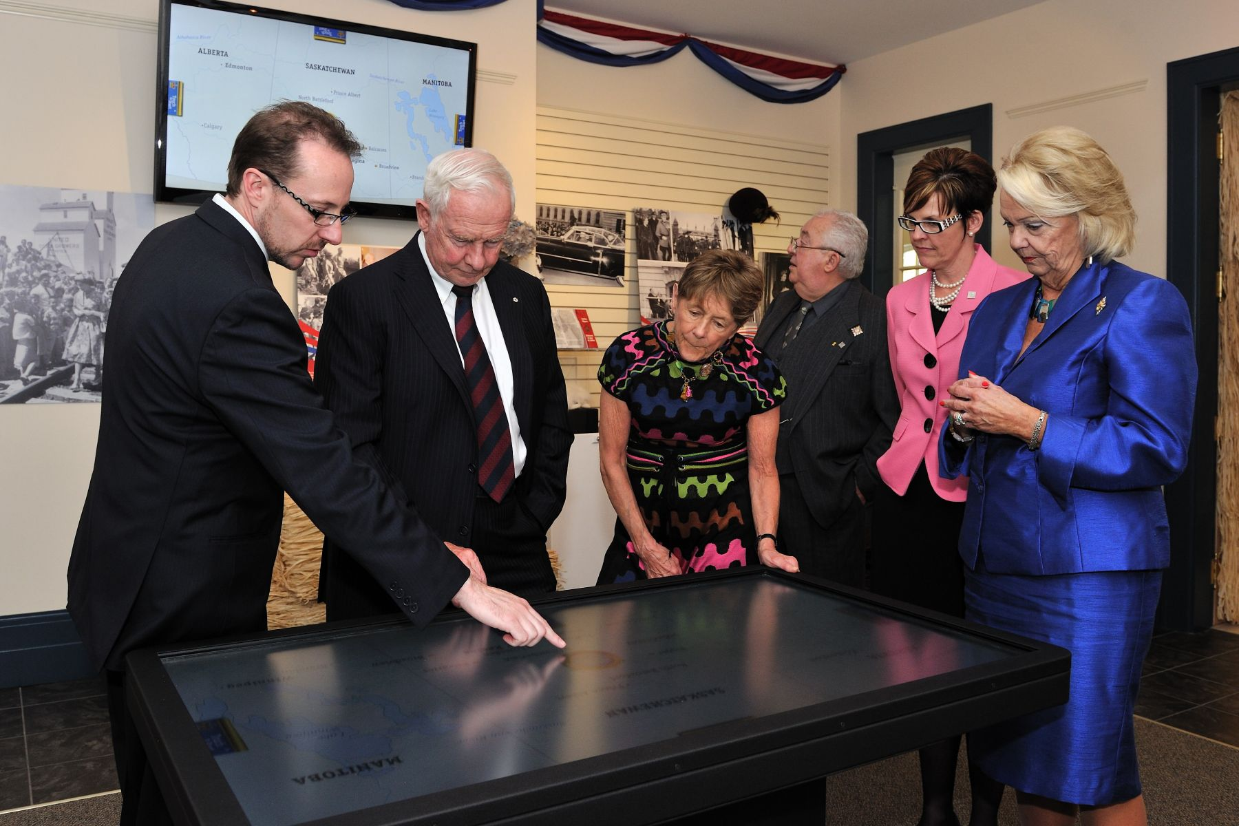Accompany by the Lieutenant-Governor, Their Excellencies toured a Diamond Jubilee display at Government House in Saskatchewan.