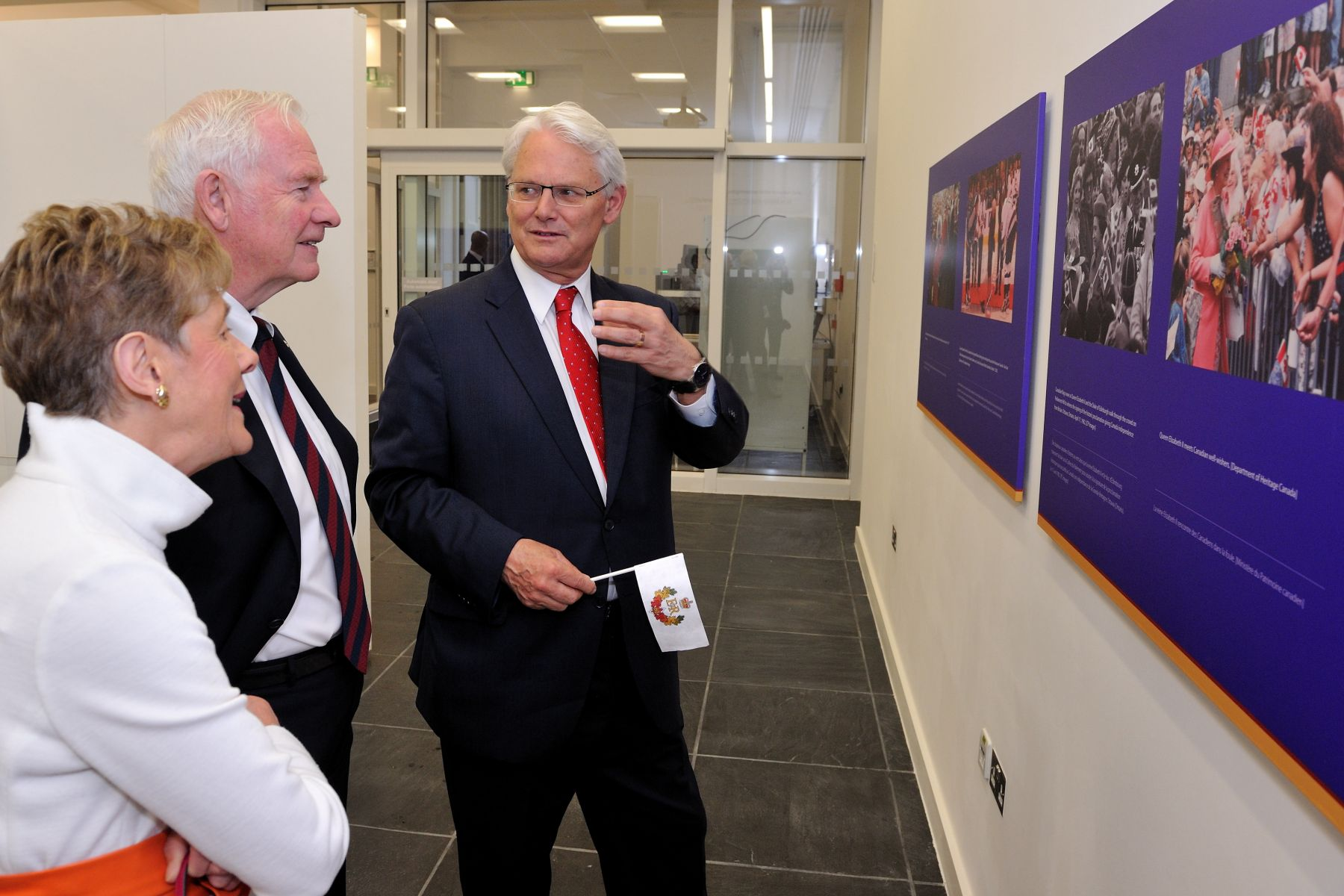 At Canada House, Their Excellencies toured a photographic exhibit of The Queen's visits to Canada. They were accompanied by Mr. Gordon Campbell.