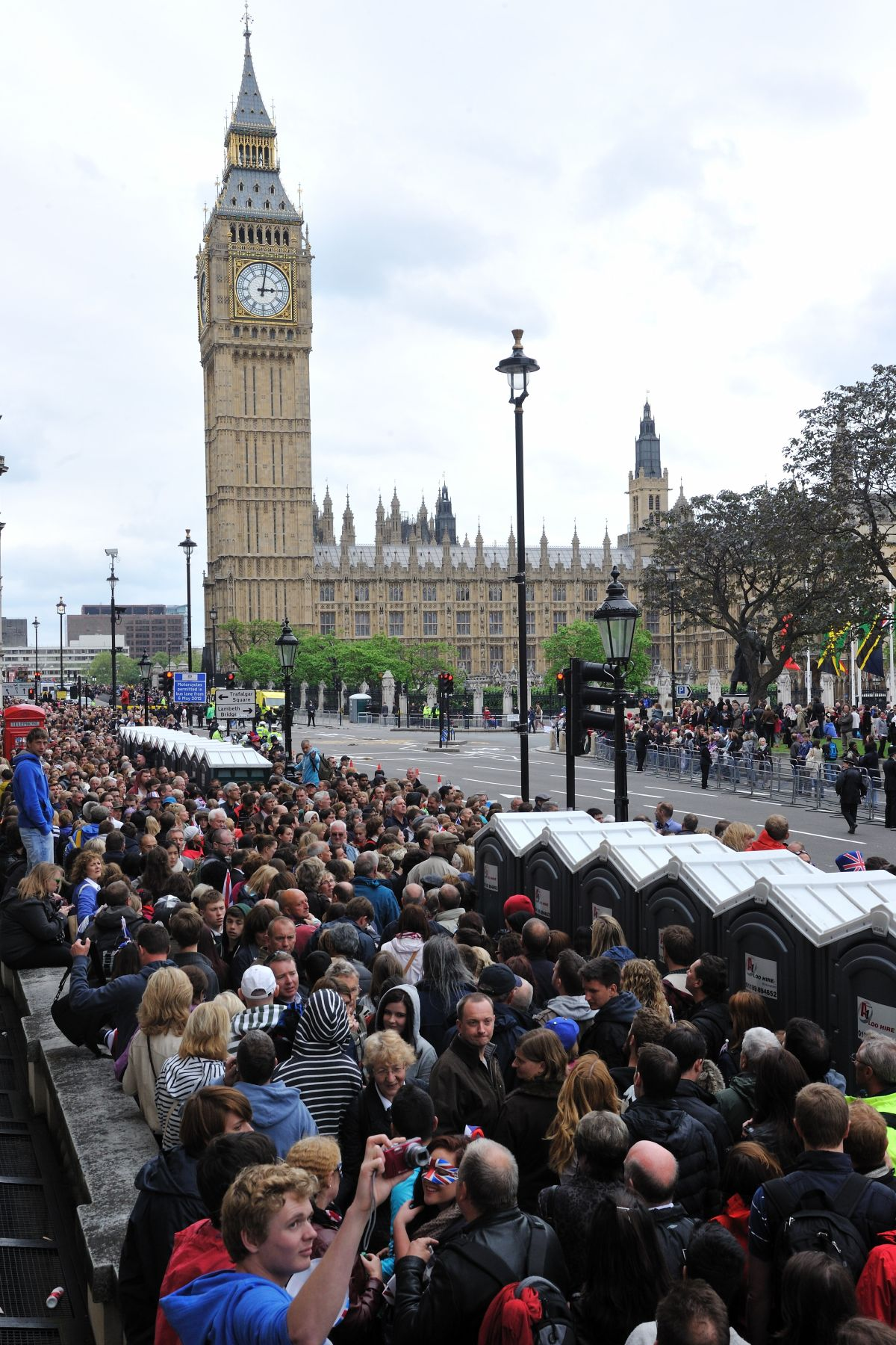 Crowds gathered on each sides of streets of downtown London, eager to see the Royal Family Carriage Procession.