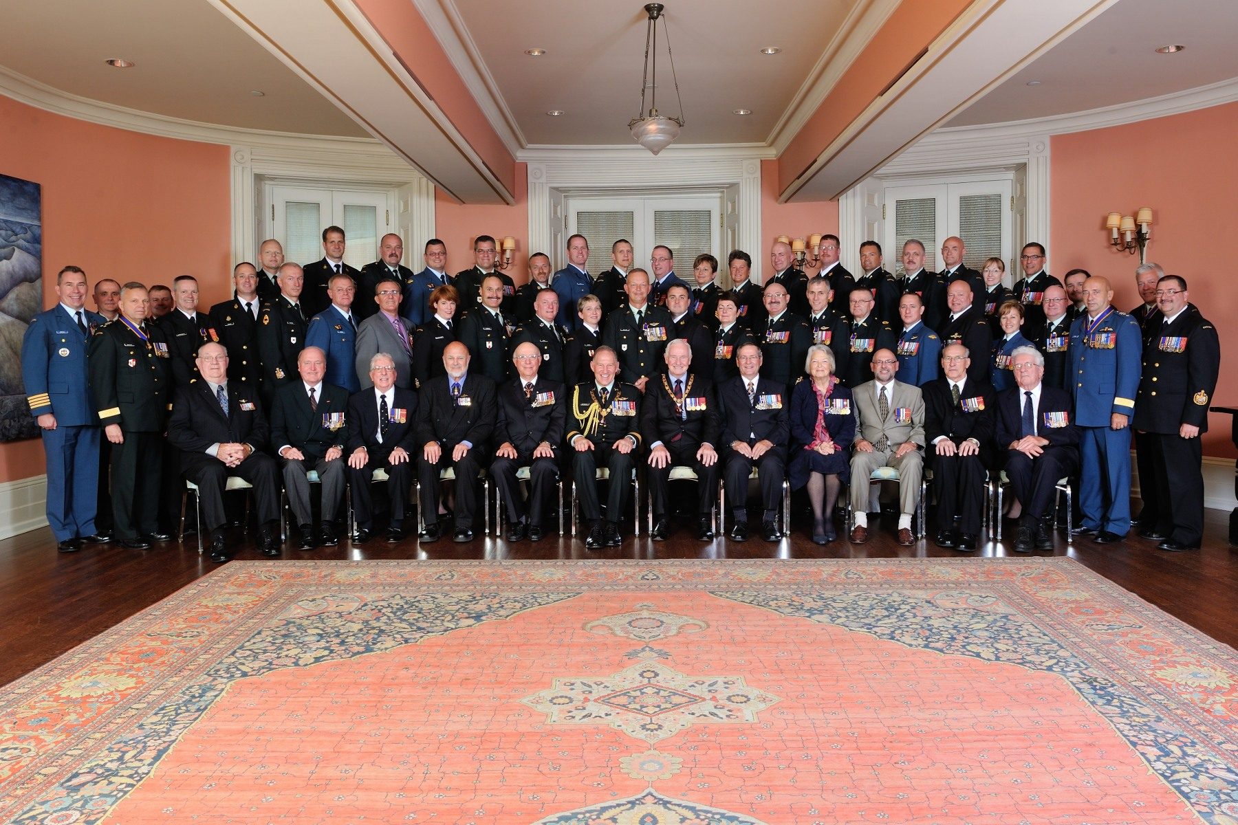 In this picture, the group was joined by eight recipients from the first presentation of the Order of Military Merit in 1972 and by former Chiefs of the Defence Staff, General Maurice Baril, O.C., C.M.M., M.S.M., C.D. (Ret'd) and General Paul D. Manson, O.C., C.M.M., C.D. (Ret'd).