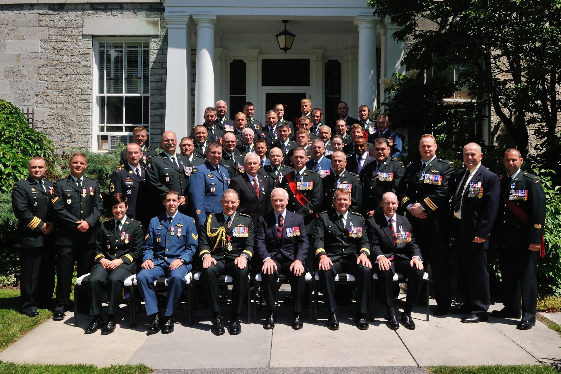 His Excellency the Right Honourable David Johnston, Governor General of Canada, and General Walt Natynczyk, Chief of the Defence Staff, are pictured with the 43 recipients who were presented with military decorations.