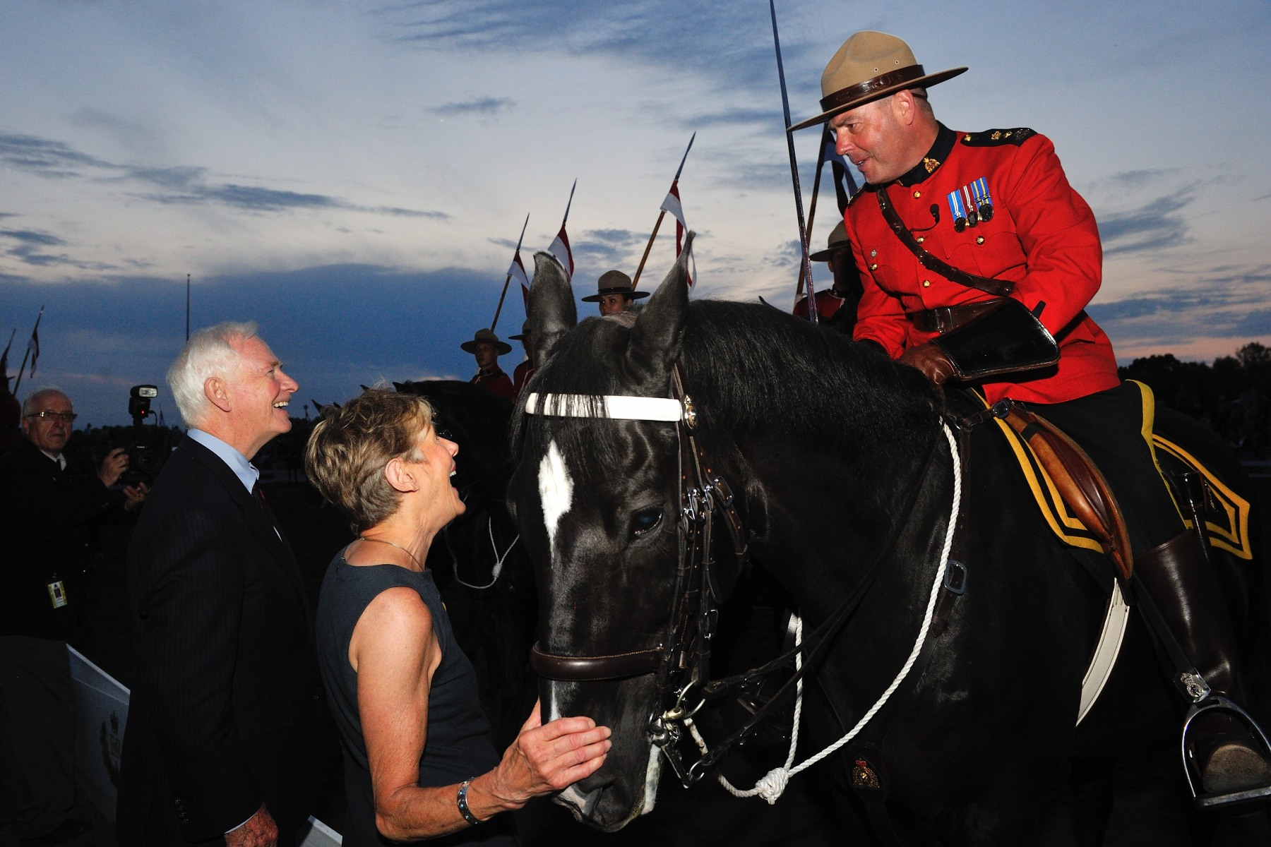 Their Excellencies congratulated Superintendent Marty Chesser on the Musical Ride's spectacular performence.