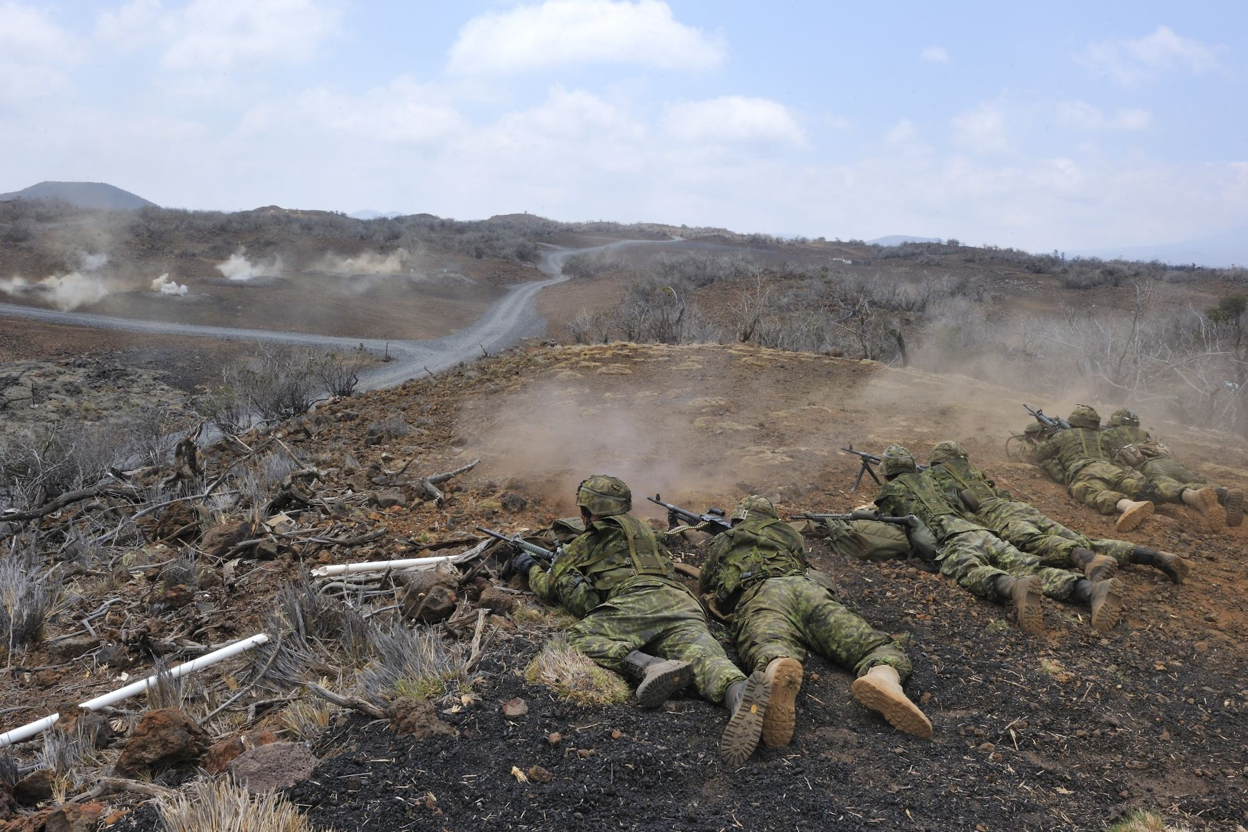 Members of 2 PPCLI firing towards targets on the range during the Live-Fire training exercise.