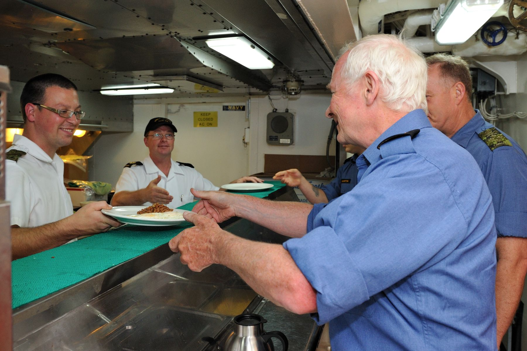 On the morning of July 22, His Excellency had breakfast on board Her Majesty's Canadian Ship (HMCS) Ottawa.