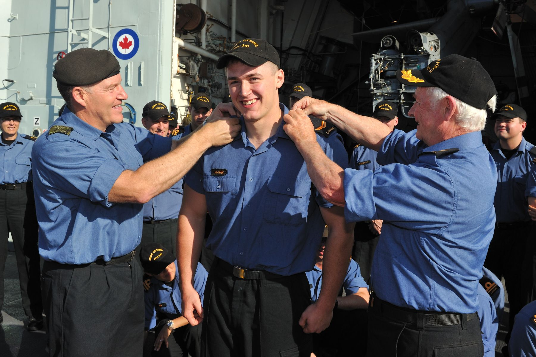 Among other promotions, His Excellency and General Natynczyk promoted Leading Seaman Mann.