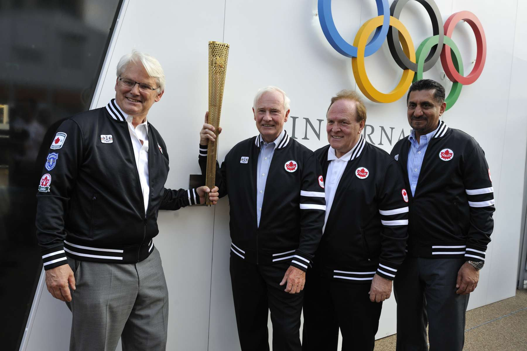 The Governor General held a replica of the Olympic flame.