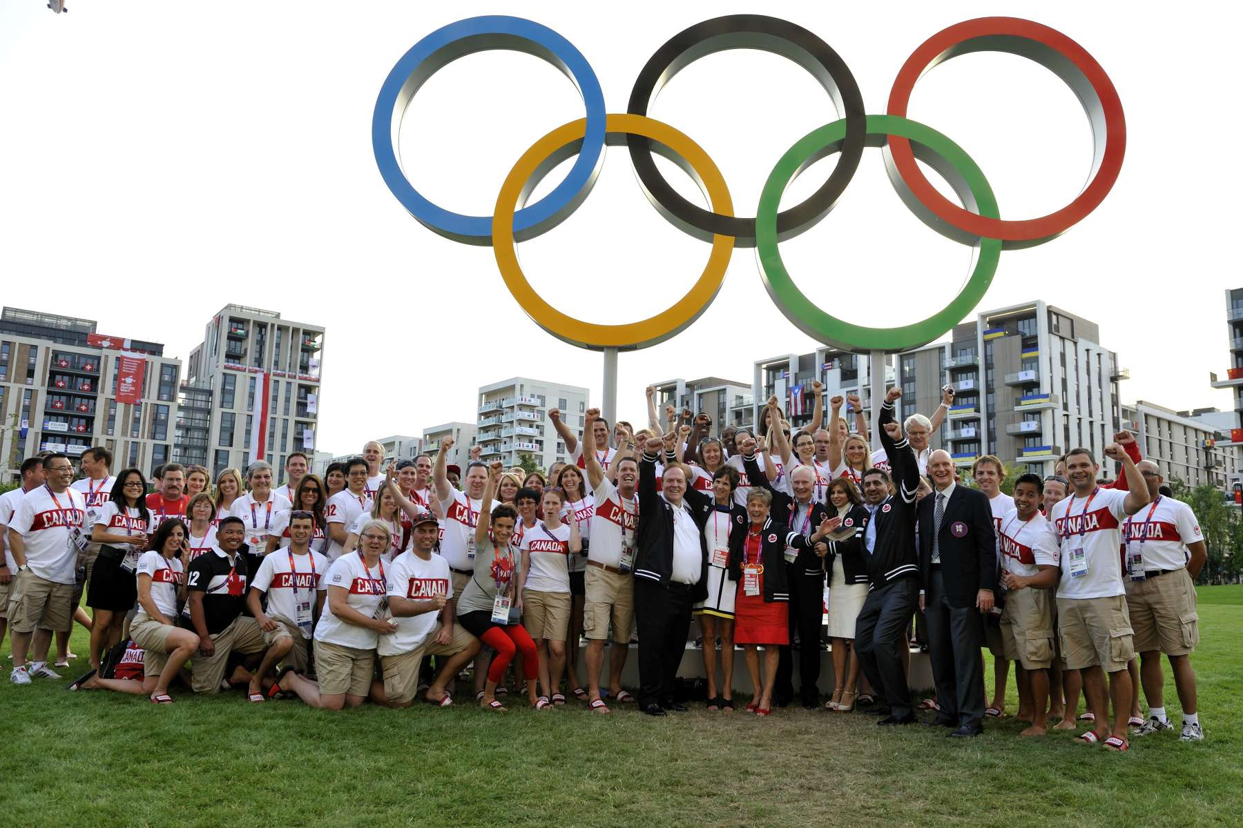 Official photo of Their Excellencies with Canadian Olympic Team athletes and coaching staff at the Athletes' Village.