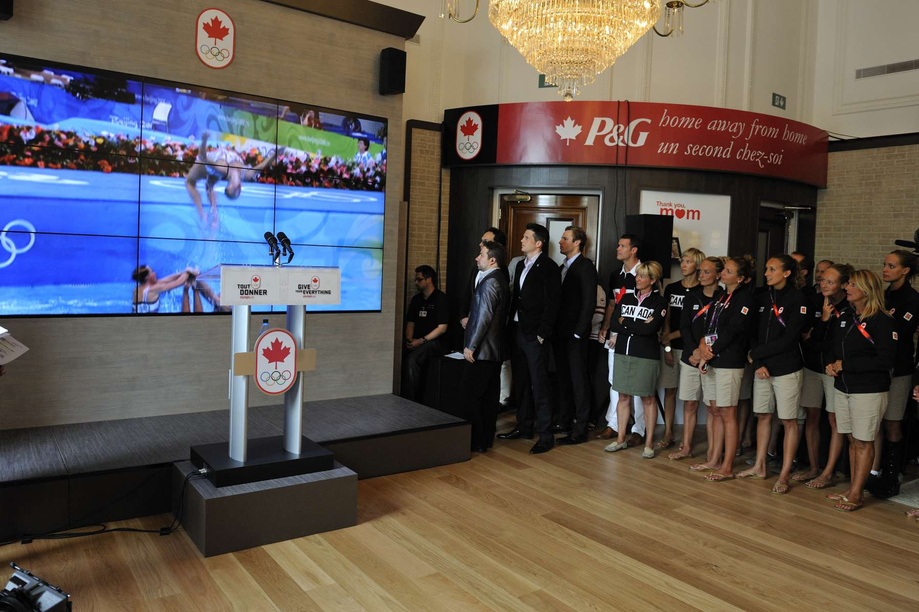 Canadian athletes, their family members and friends and guests watched a video highlighting our athletes' best performances in previous summer Olympic Games.