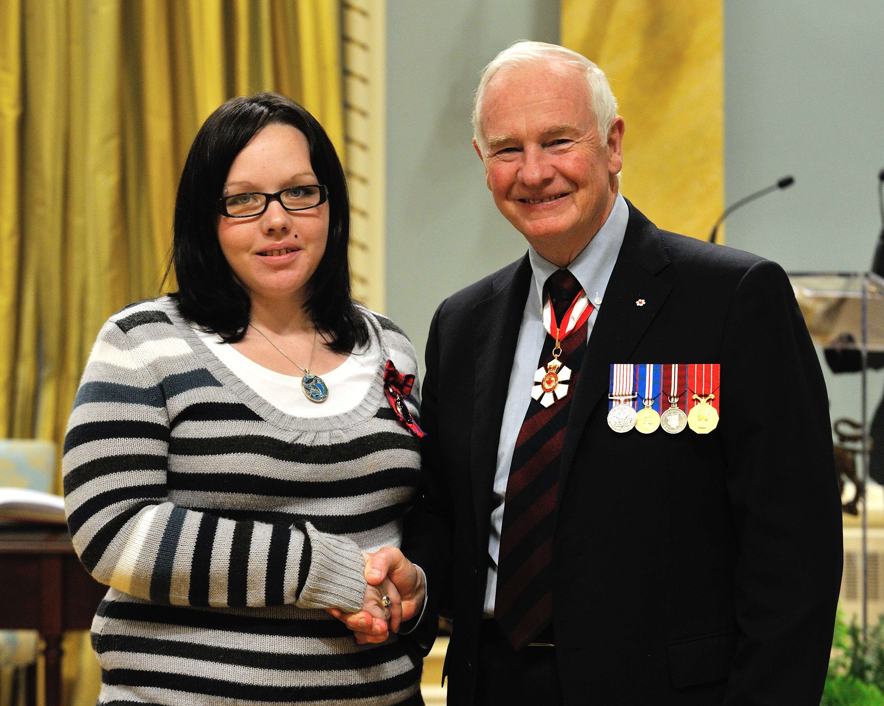 On November 19, 2008, Daniel Chrusch, Vincent Fontaine and Candace Smith (pictured) rescued a man from a burning house, in Pine Falls, Manitoba. Ms. Smith, Mr. Fontaine and his elderly father, who lived in the house, woke up to find their living room on fire and their exit blocked. Mr. Fontaine climbed out of his bedroom window, but unfortunately, his father had fallen unconscious in the hallway and Ms. Smith was trapped in her bedroom. Their neighbour, Mr. Chrusch, entered the house and, after withdrawing several times because of the heat and smoke, called out to the victims to come towards his voice. Crawling beneath the smoke, Ms. Smith grabbed the elderly victim and dragged him towards Messrs. Chrusch and Fontaine, who helped bring him outside.