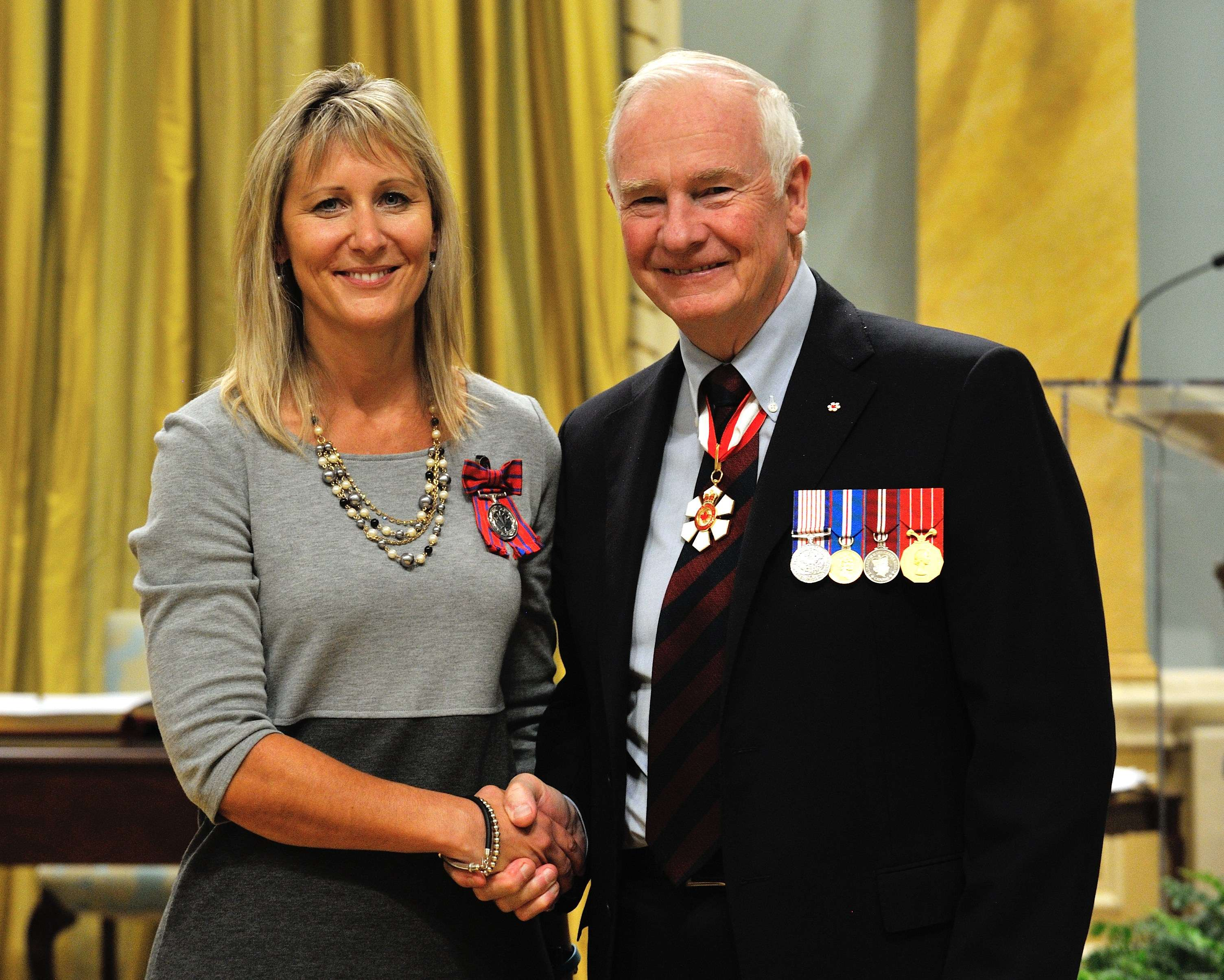 On January 29, 2009, Detective Constable Brad Fraser, of the Victoria Police Department, and Jacqueline Vanderwood (pictured) rescued an injured woman from a damaged vehicle following a head-on collision, near Valemount, British Columbia. Detective Constable Fraser and Ms. Vanderwood were driving by when they spotted the wrecked cars: smoke billowed from the engines and fuel leaked onto the pavement. The occupants of the first vehicle had not survived the collision, but the three passengers in the second car were still alive. While other passersby pried open the front doors to retrieve the driver and front passenger, Detective Constable Fraser crawled through a small opening of the rear door to reach a woman in the back seat. Fearing that the fuel could catch fire at any moment, Detective Constable Fraser quickly untied the woman's seat belt and, with the help of Ms. Vanderwood, carried her to safety. All three victims of the second vehicle survived.