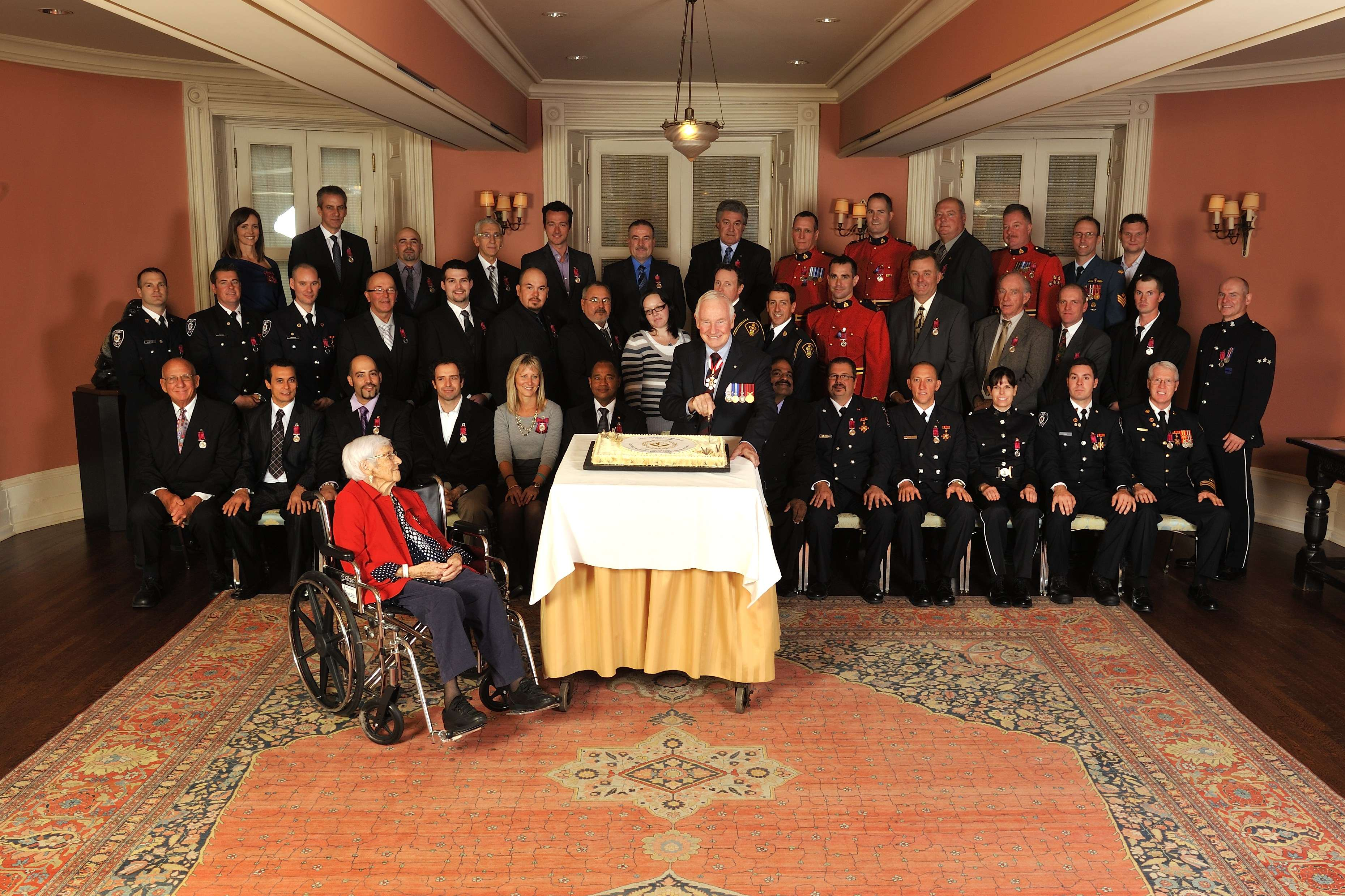The Governor General was invited to cut a cake in honour of the 40th anniversary of the Decorations for Bravery. He is pictured with the recipients who were honoured during the ceremony.