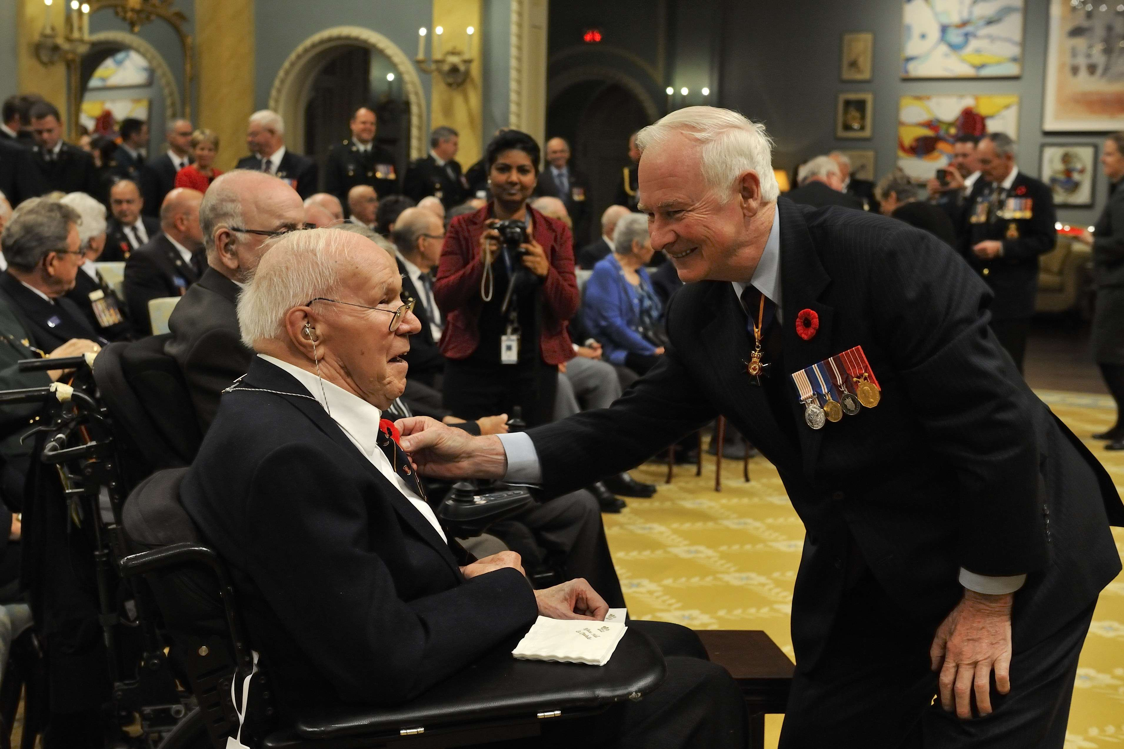 Following the ceremony, His Excellency gave poppies to guests, including Mr. Jon Mosley, a Second World War veteran.