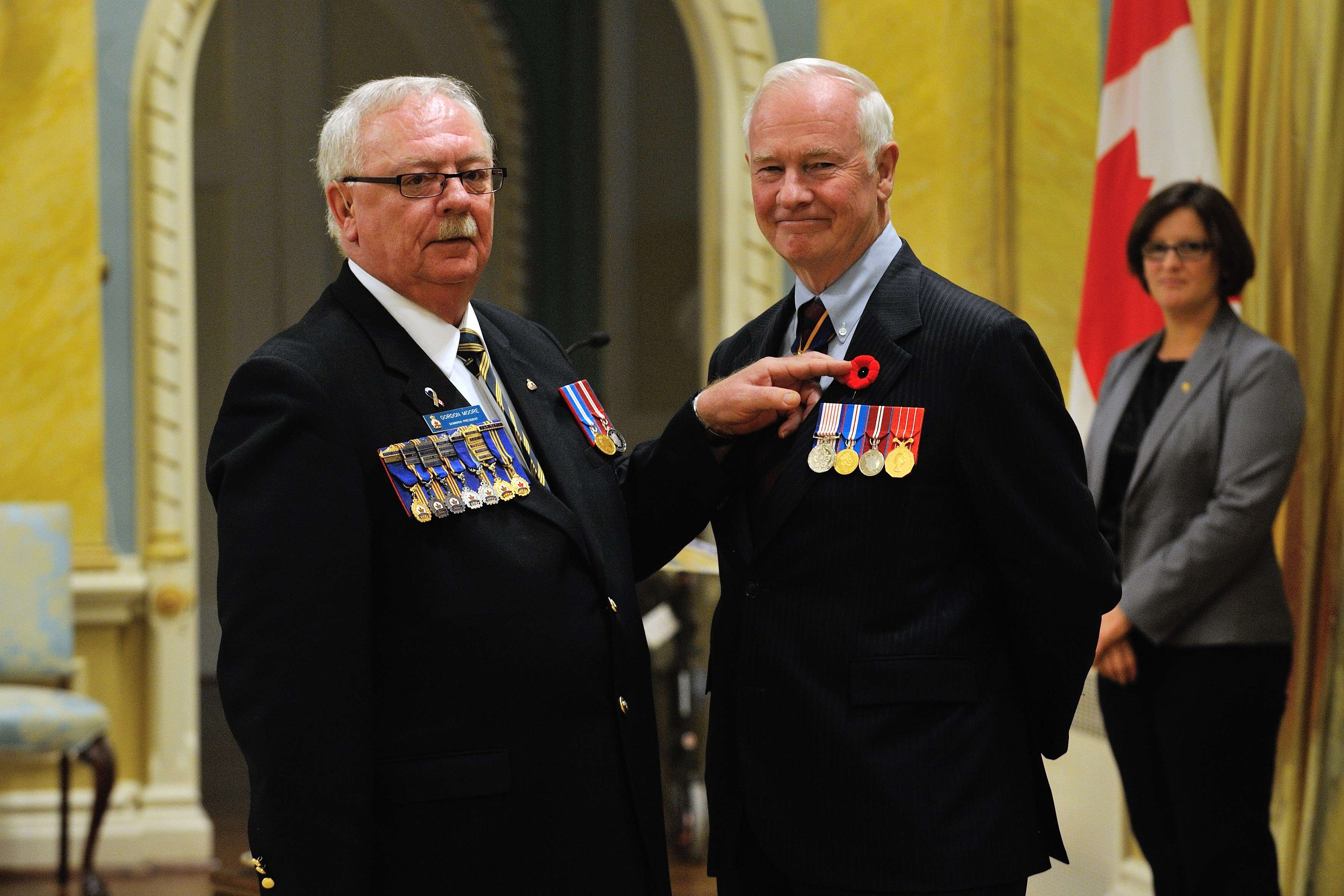 His Excellency, who is patron of The Royal Canadian Legion, received the symbolic first poppy from Comrade Gordon Moore, Dominion President of The Royal Canadian Legion.