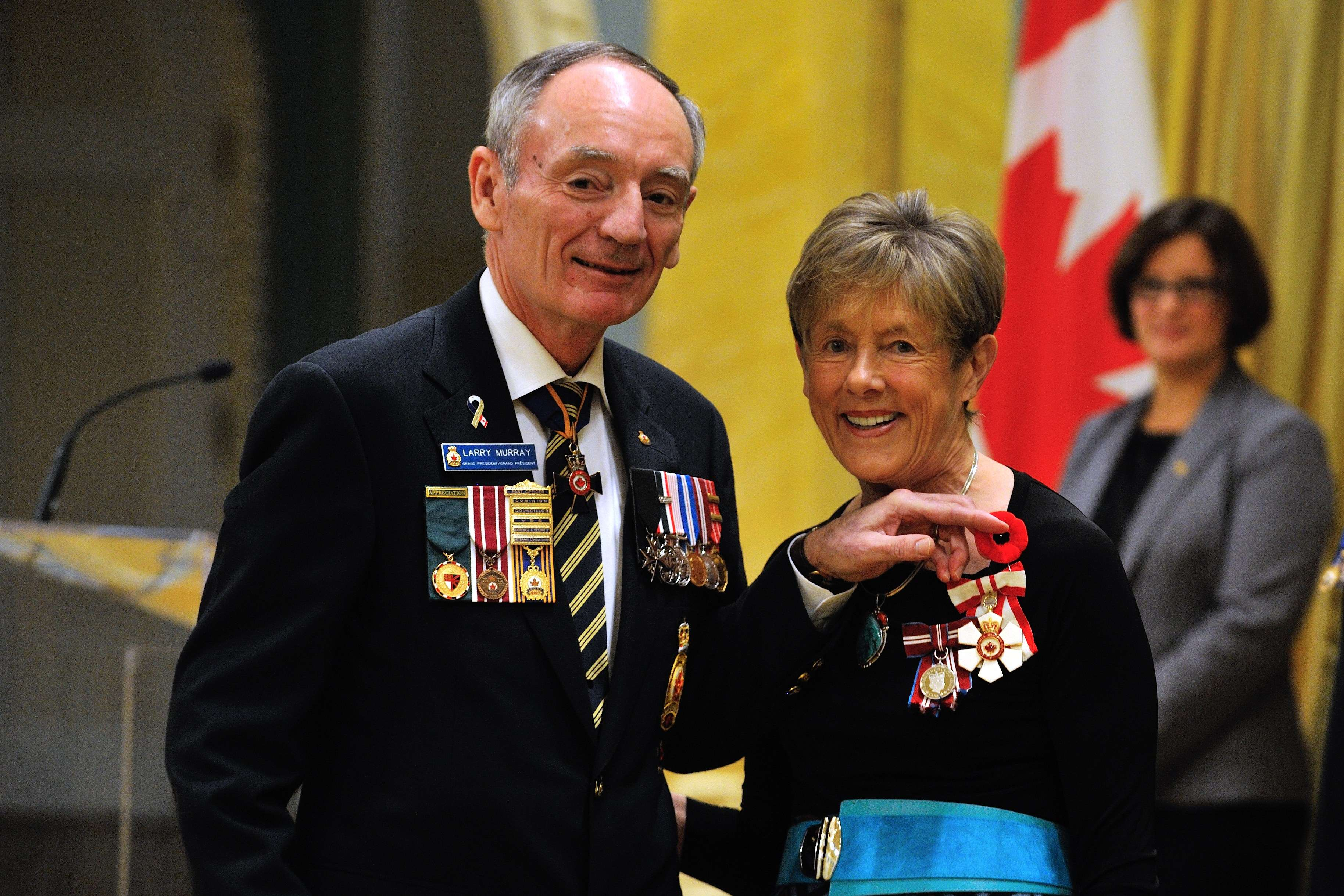Her Excellency Sharon Johnston received a poppy from Mr. Murray.